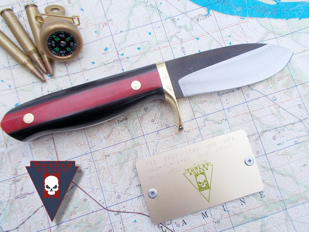 M19 with varied grind, brass half guard, black g10 scales, orange-red fleet side scales, brass bolts