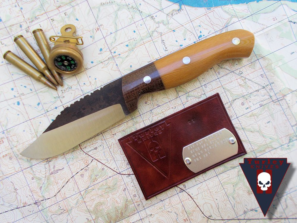 M20 with varied grind, saw teeth, barbwire micarta bolsters, natural linen micarta scales, thin red spacers, stainless loveless bolts