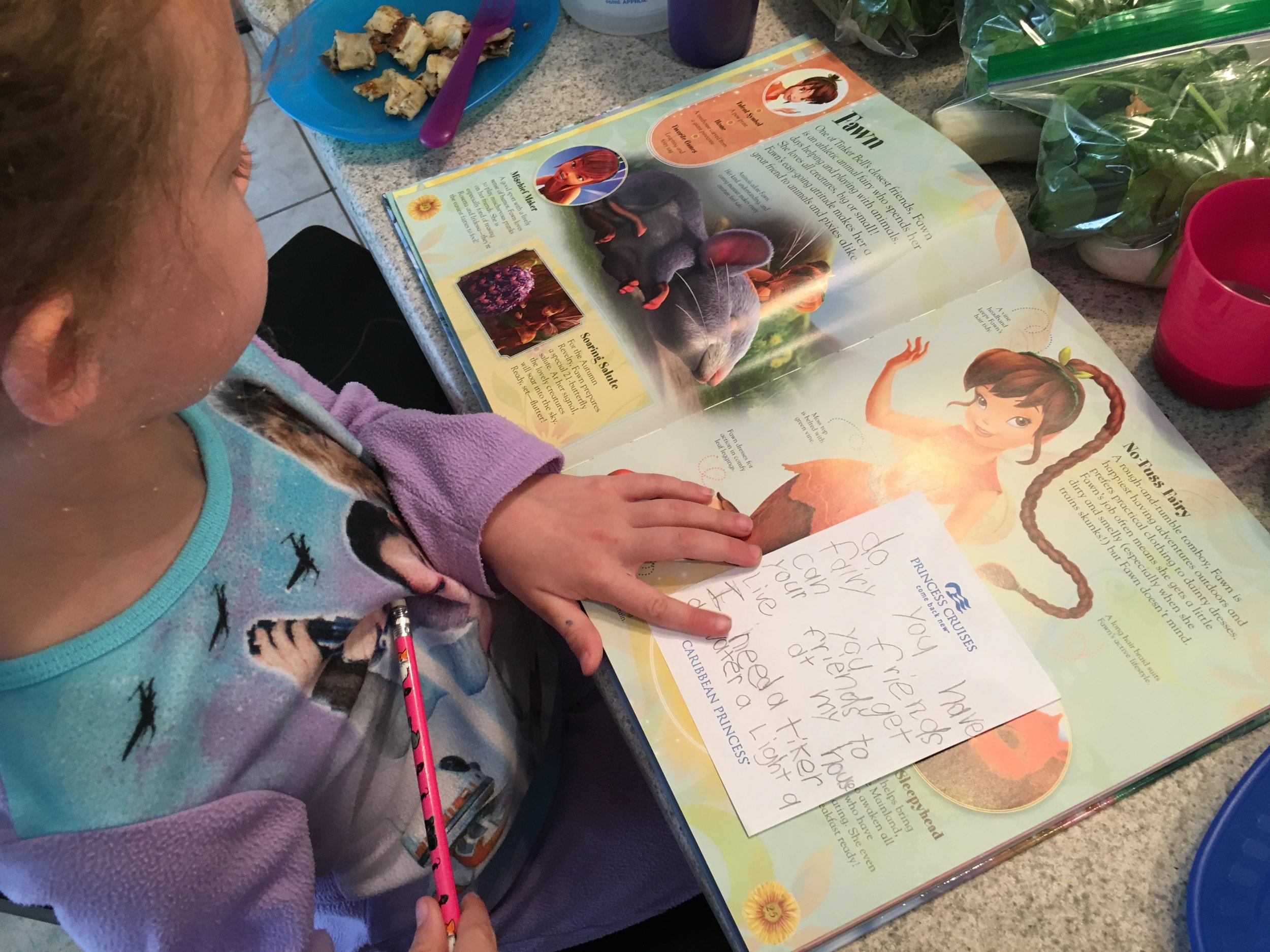 """Pouring over the fairy encyclopedia during breakfast while writing notes to Twanda """"do you have fairy friends, can you get your friends to live at my house? I need a Tinker, a Water, a light and an Animal Fairy."""""""
