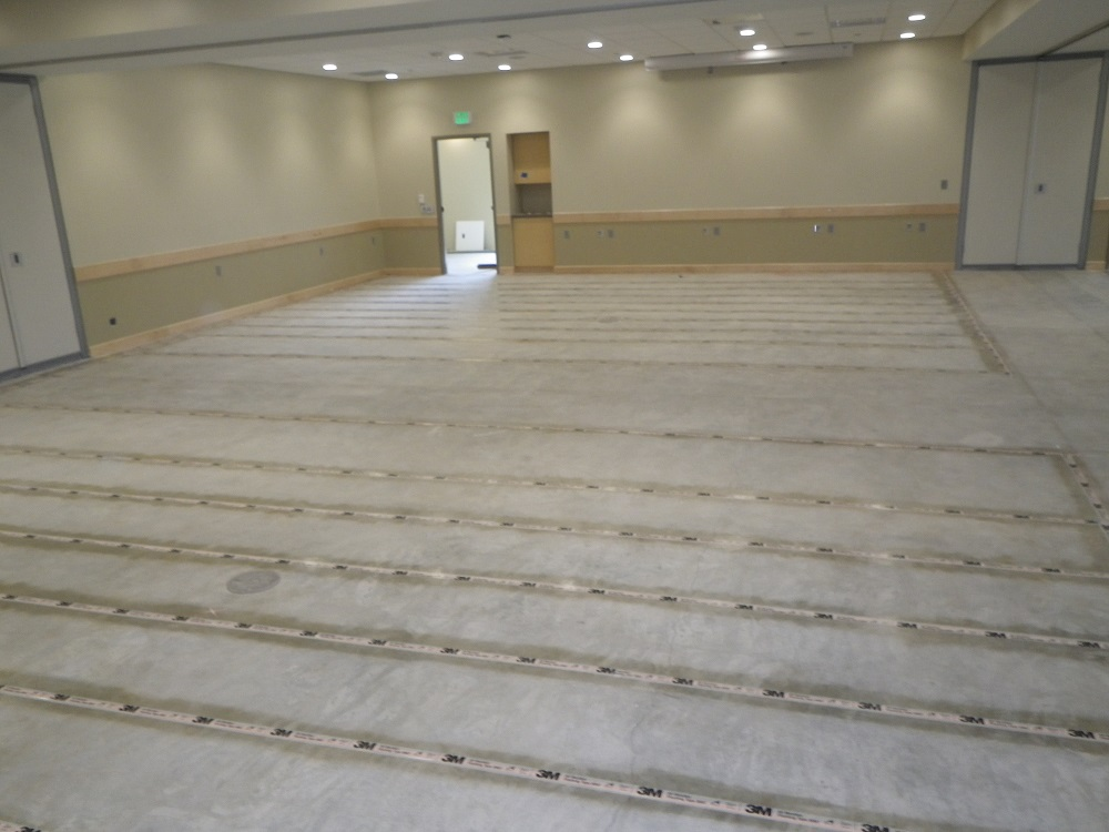 This  shows hearing loops being installed in the river room at 125 live