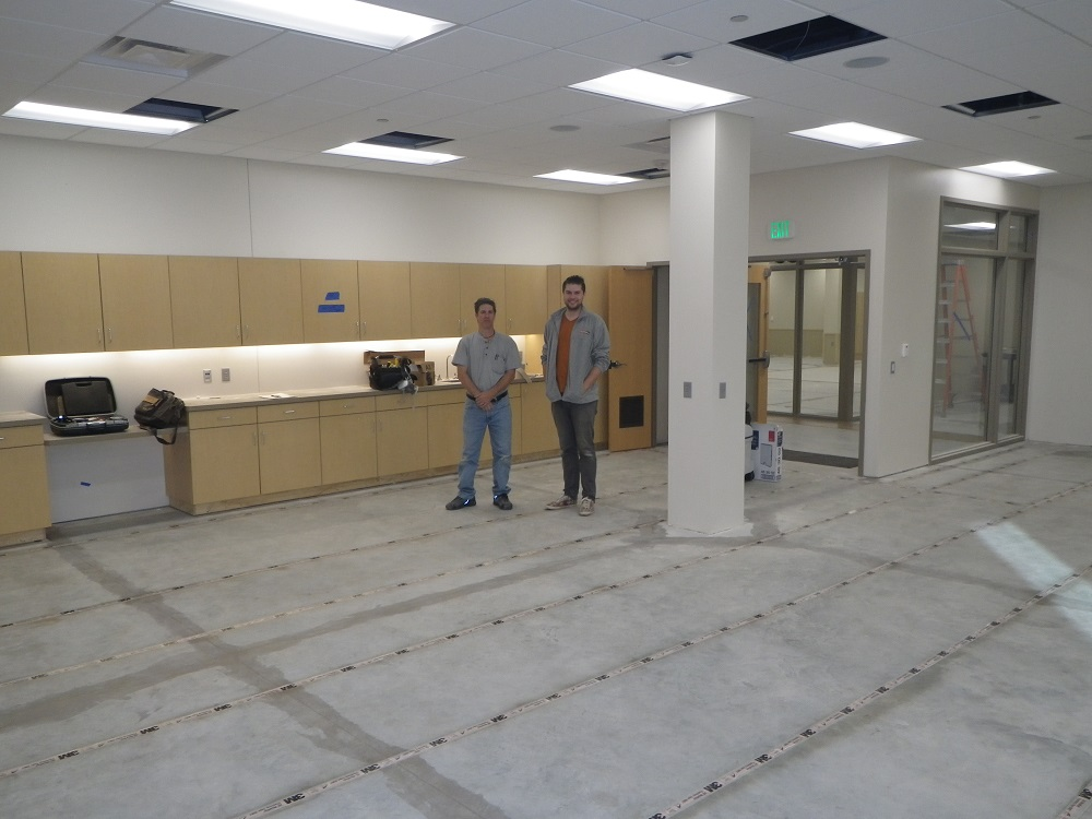 this is a picture of hearing loop installers in the activity room of 125 live