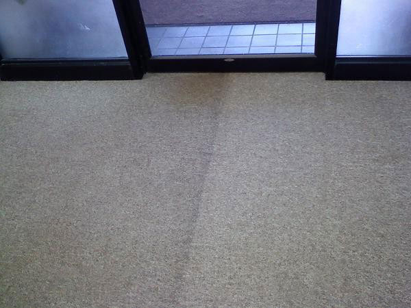 Before and after cleaning of standard household carpet.