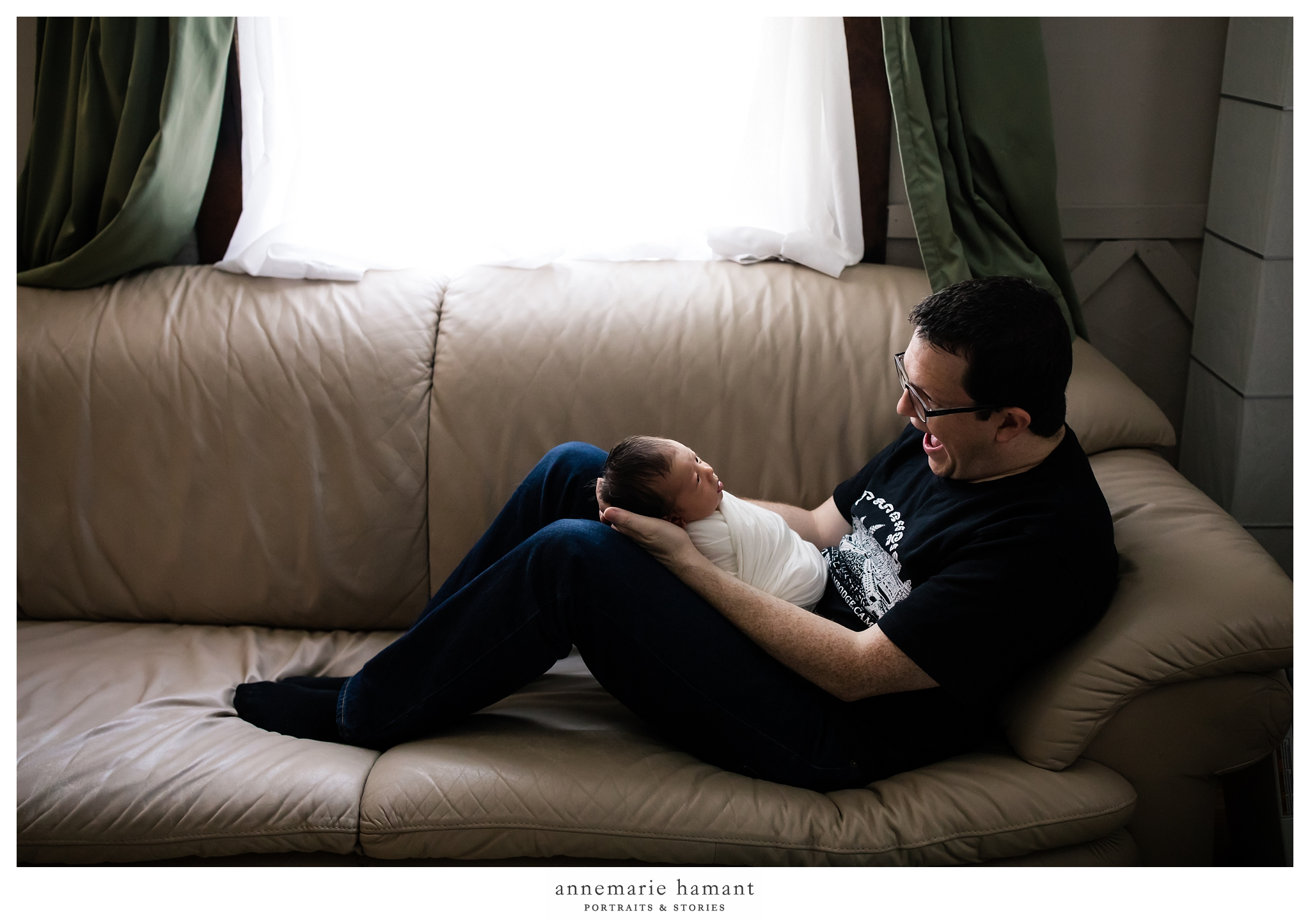 dad and newborn baby on couch