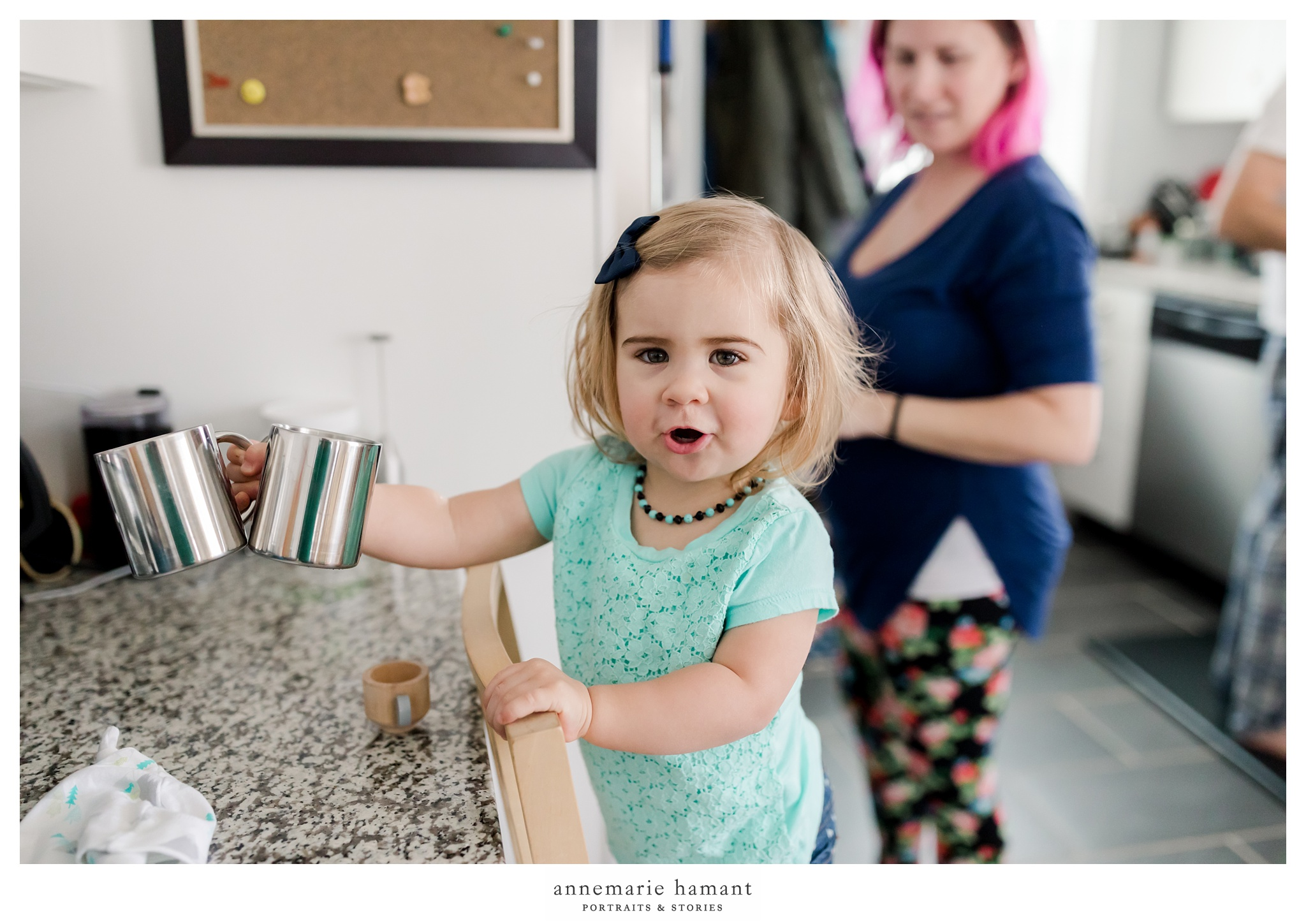toddler making coffee with mom