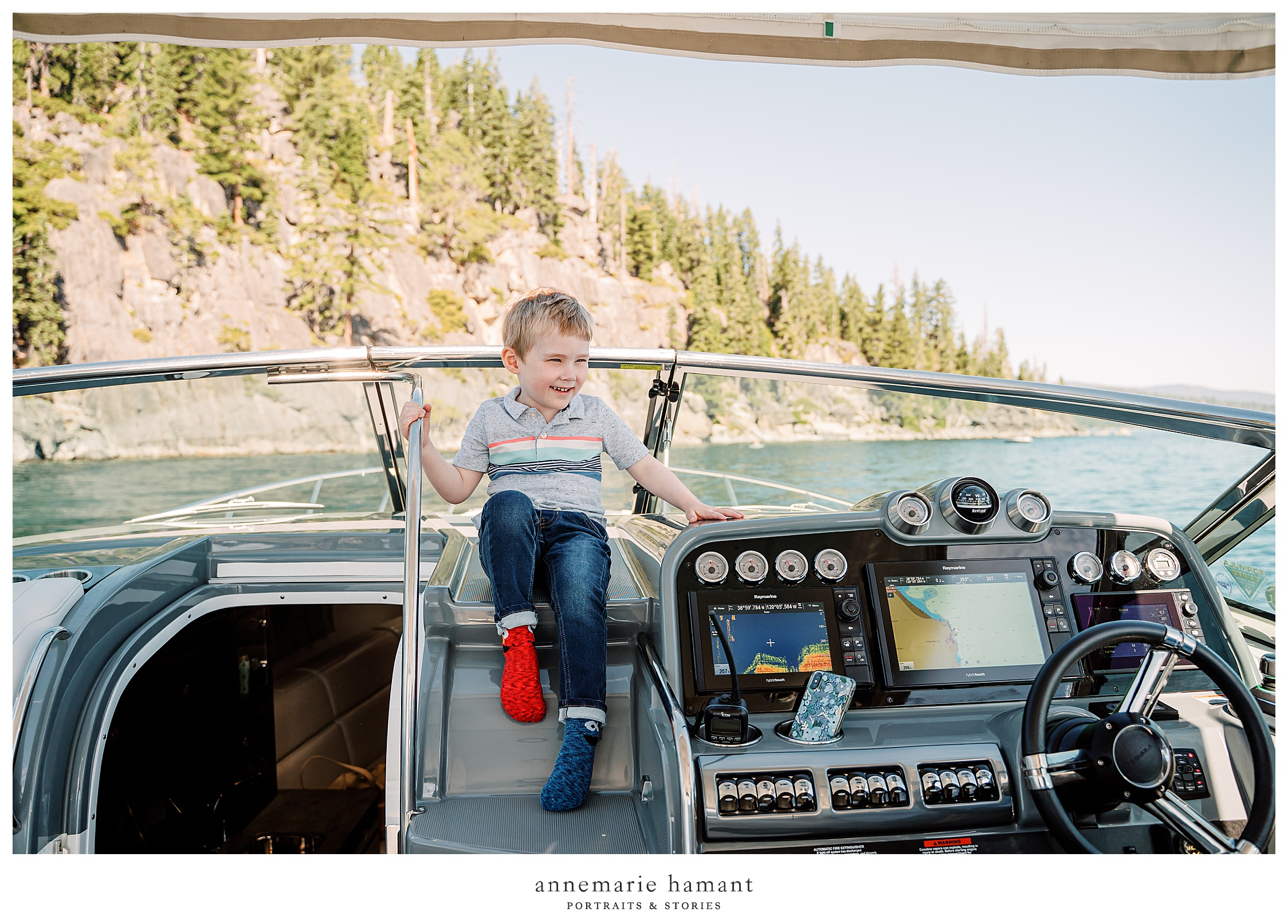 boy plays on boat on Lake Tahoe.