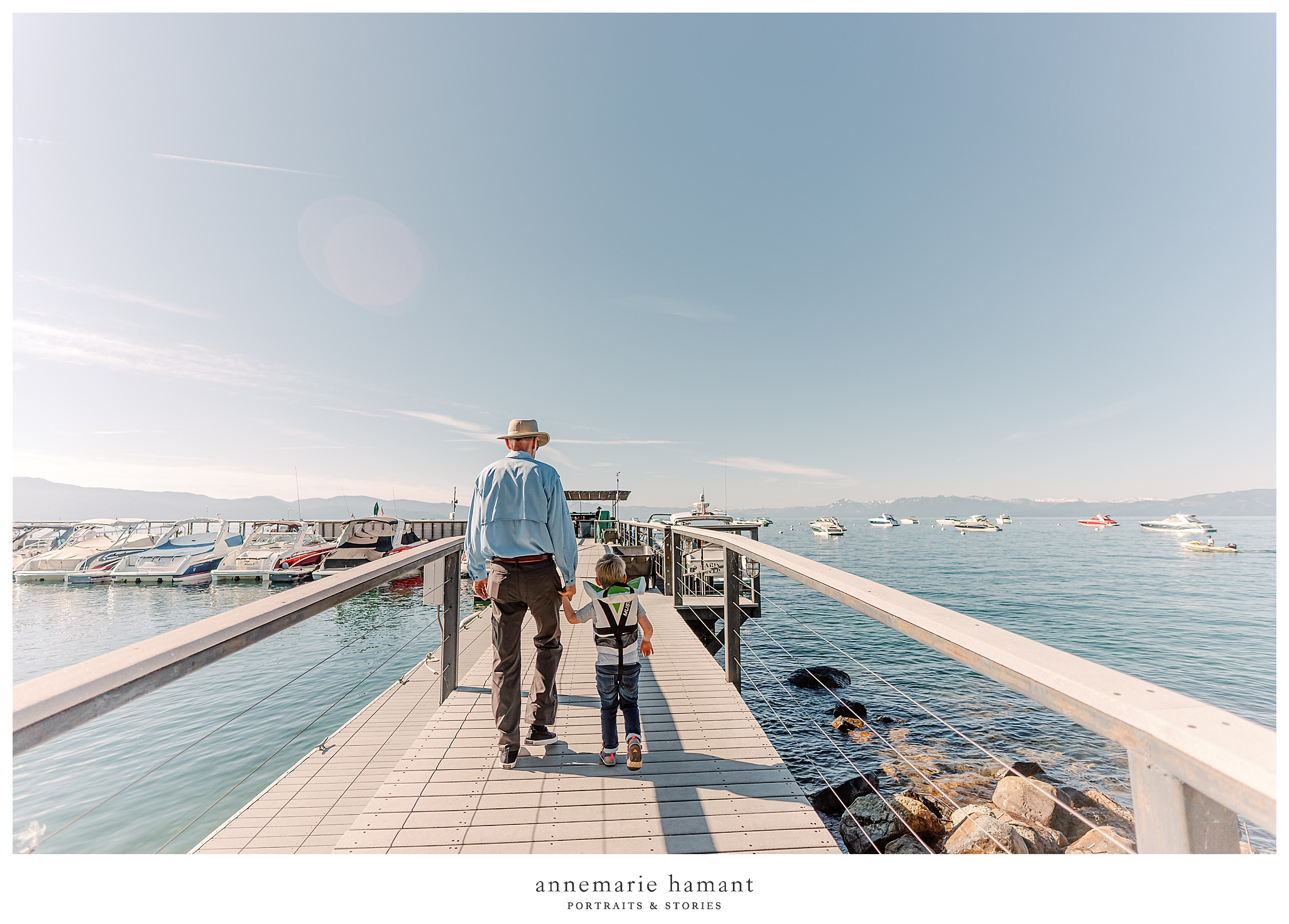 Grandfather and grandson walk the pier on Lake Tahoe.