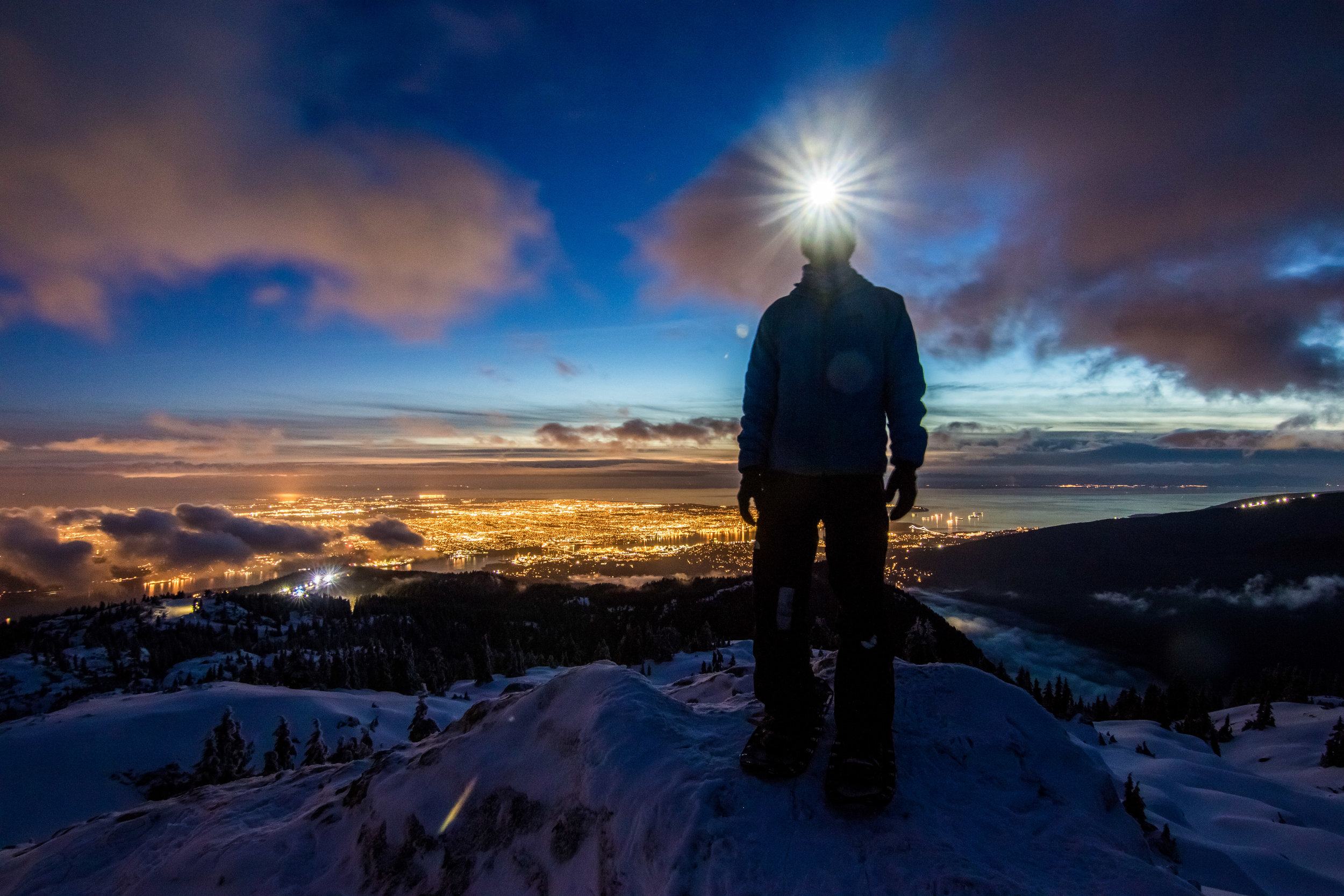 Standing on the First Peak of Mount Seymour, above the lights of Vancouver and into the realm of clouds. Self Portrait