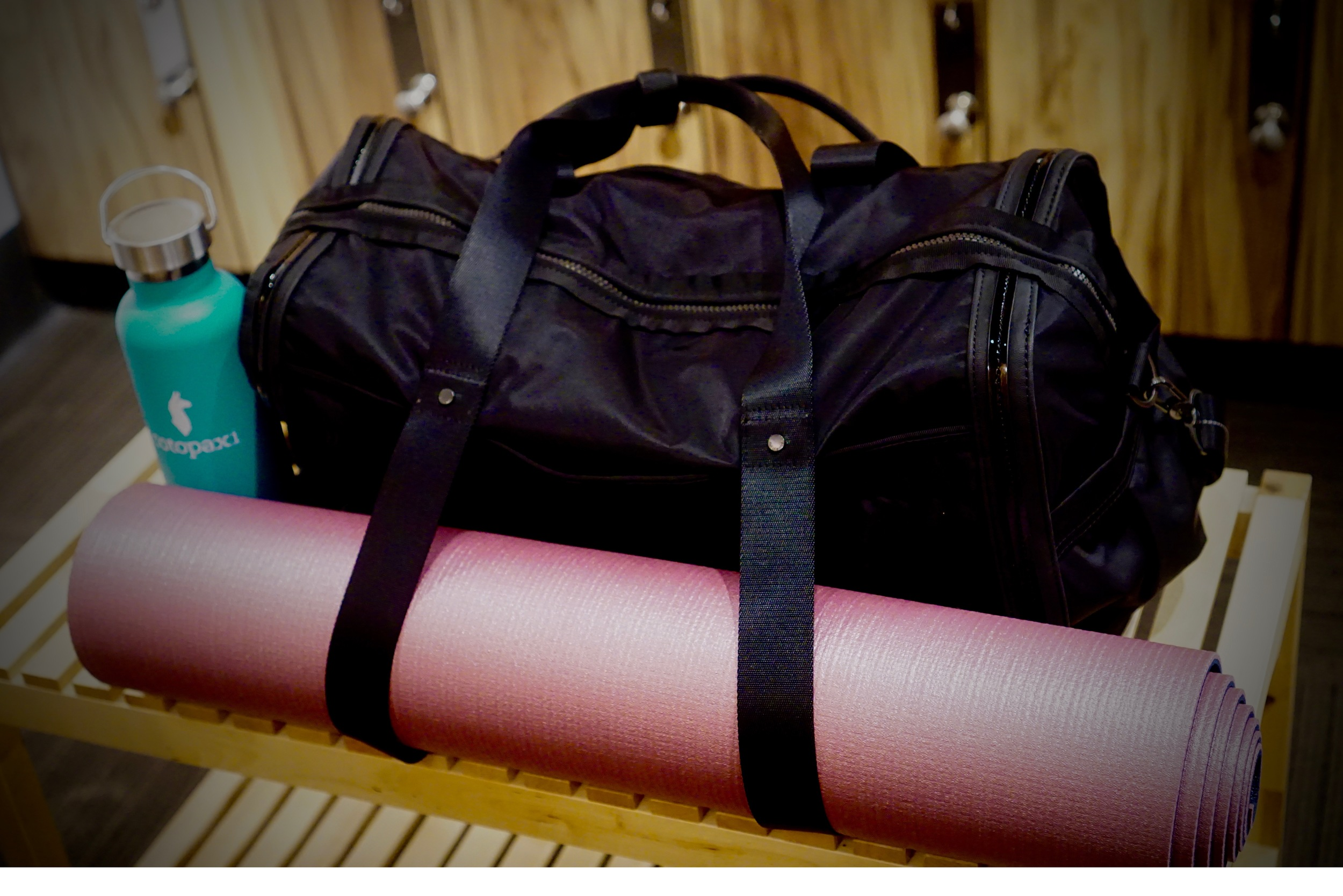 This amazing bottle keeps my water ice cool during HPF CLASS.And how cute is this duffle? It has straps to keep my yoga mat in place!  Mat: Manduka Pro-Lite ( color: sagra)