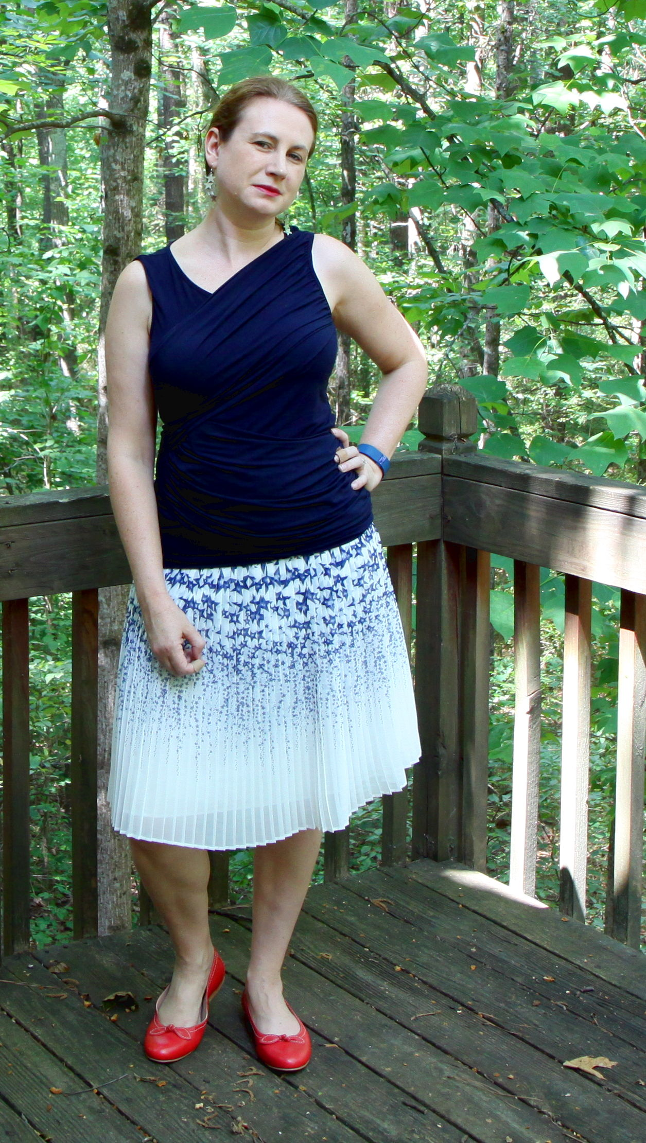 This skirt is perfect for the Fourth but it also can work for work, church, special occasions, and more! Outfit:  PLEATED STAR SKIRT,   SLEEVELESS DOUBLE DRAPE TEE,   AND   BOW BALLET FLATS.