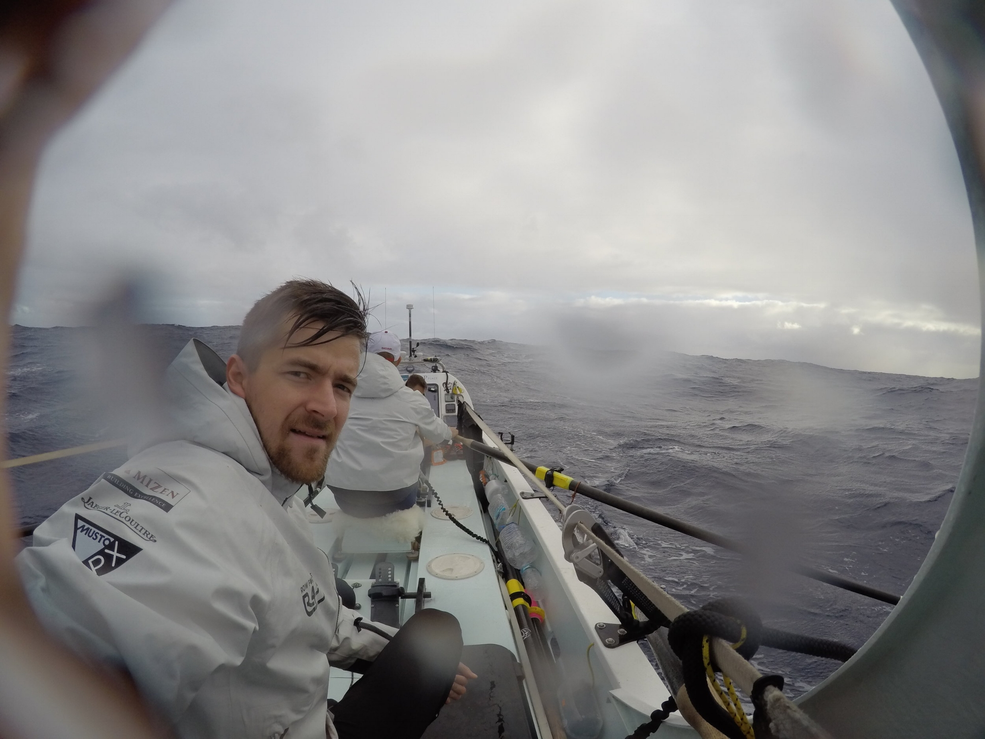 Rowing through the rain out on the Atlantic