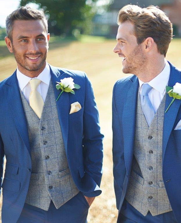 Two men wearing wedding suits, elegans reading, mens accessory hire