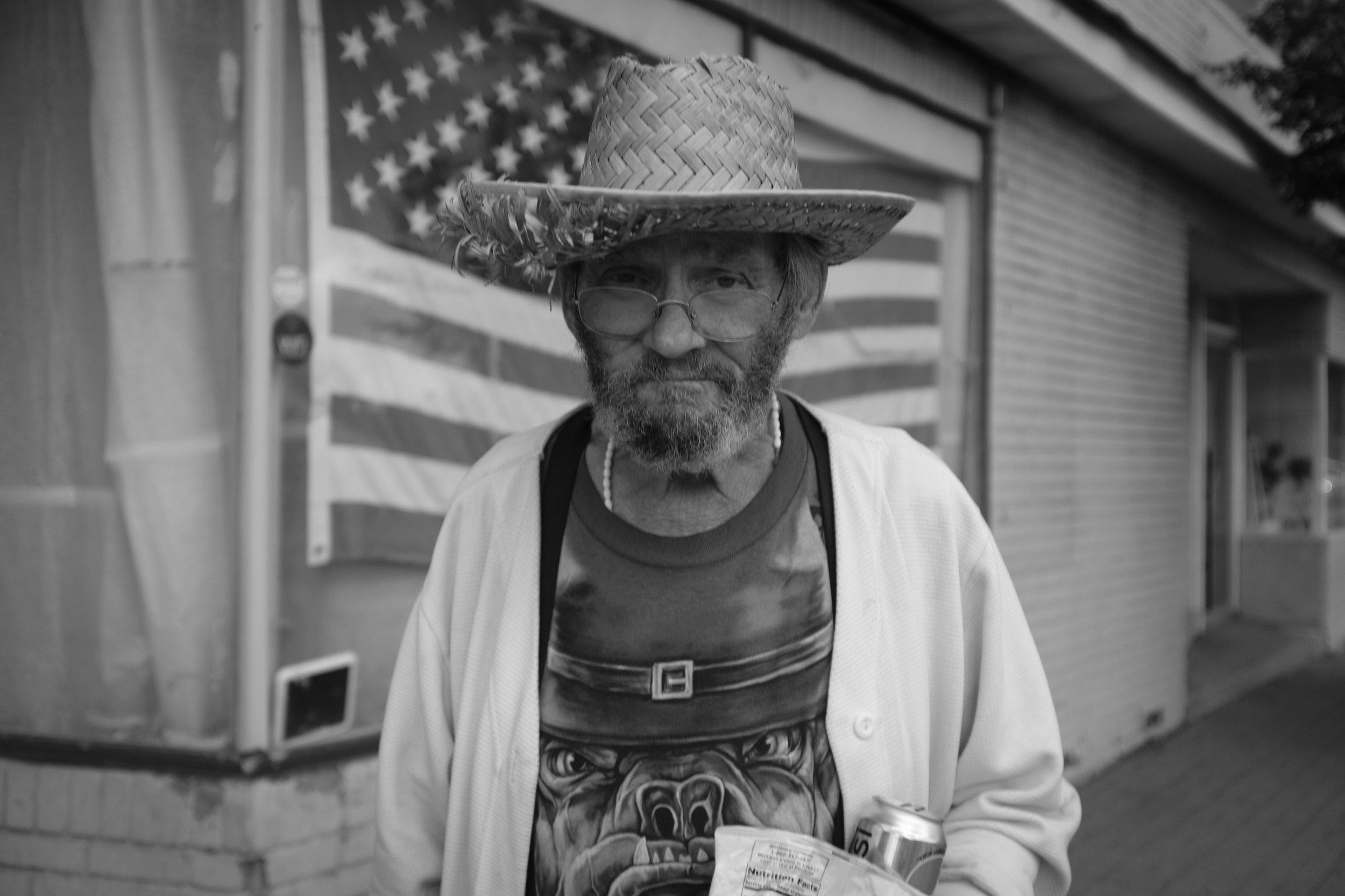 Man in straw hat, Kingston, NY. 2017.