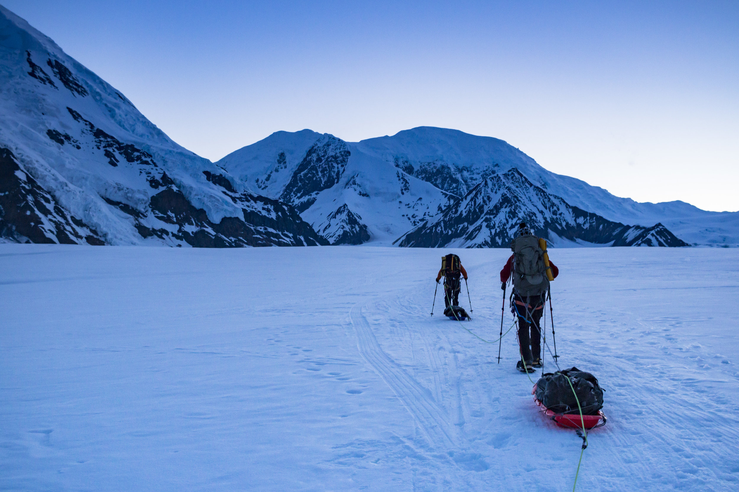 Dragging our gear across the glacier on day one.