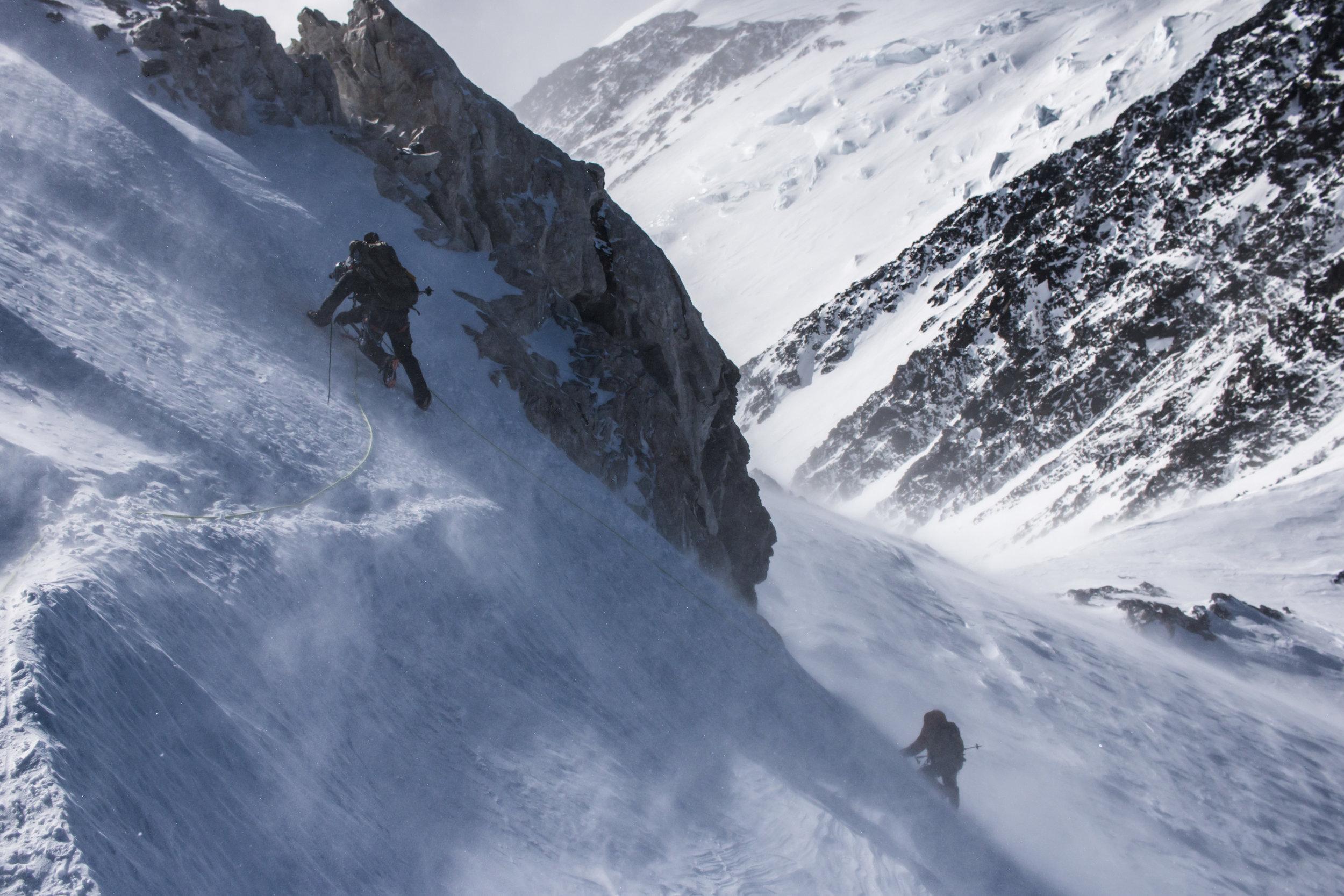 Down-climbing a steep section on Denali Pass.