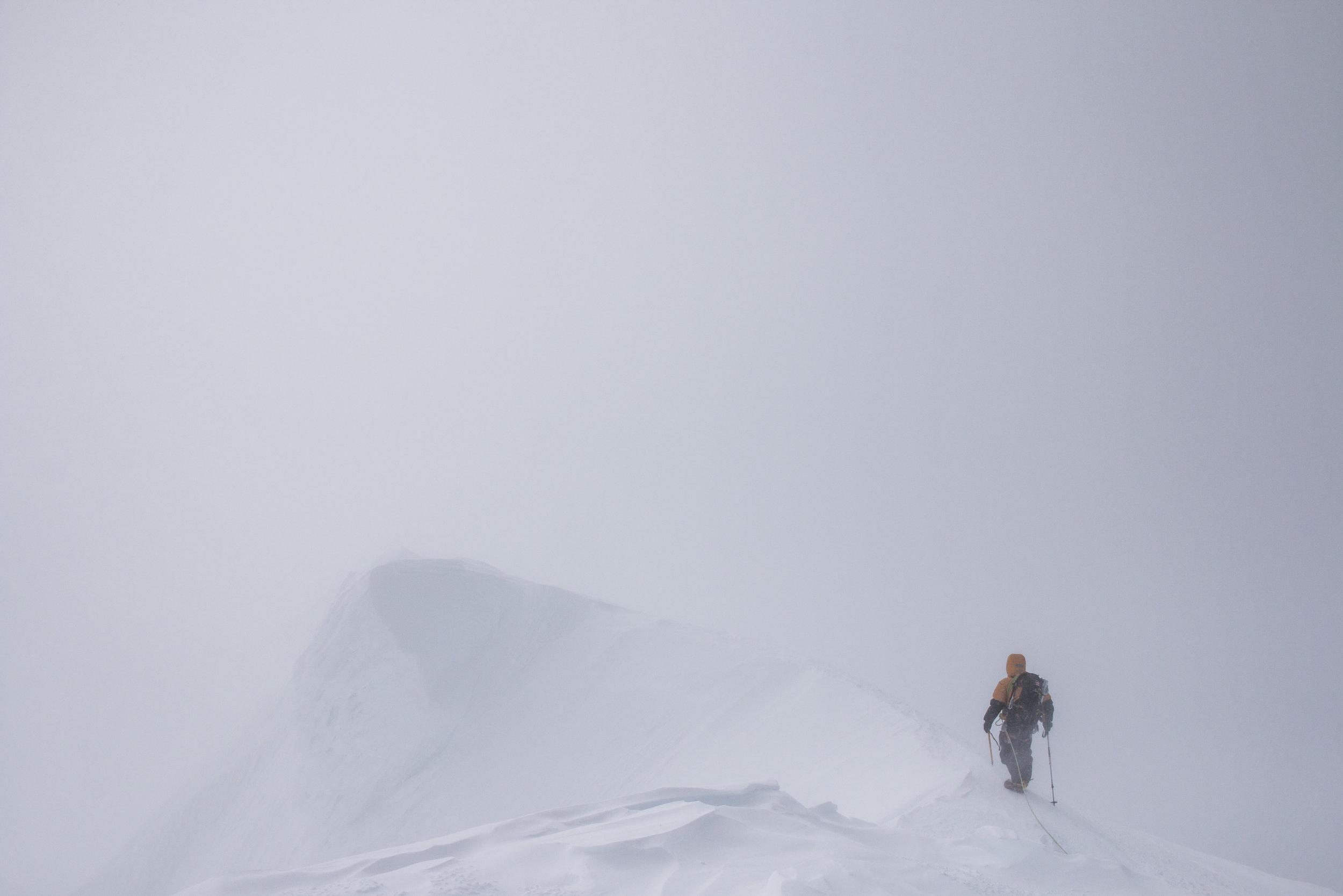 Clayton leading us off the summit.