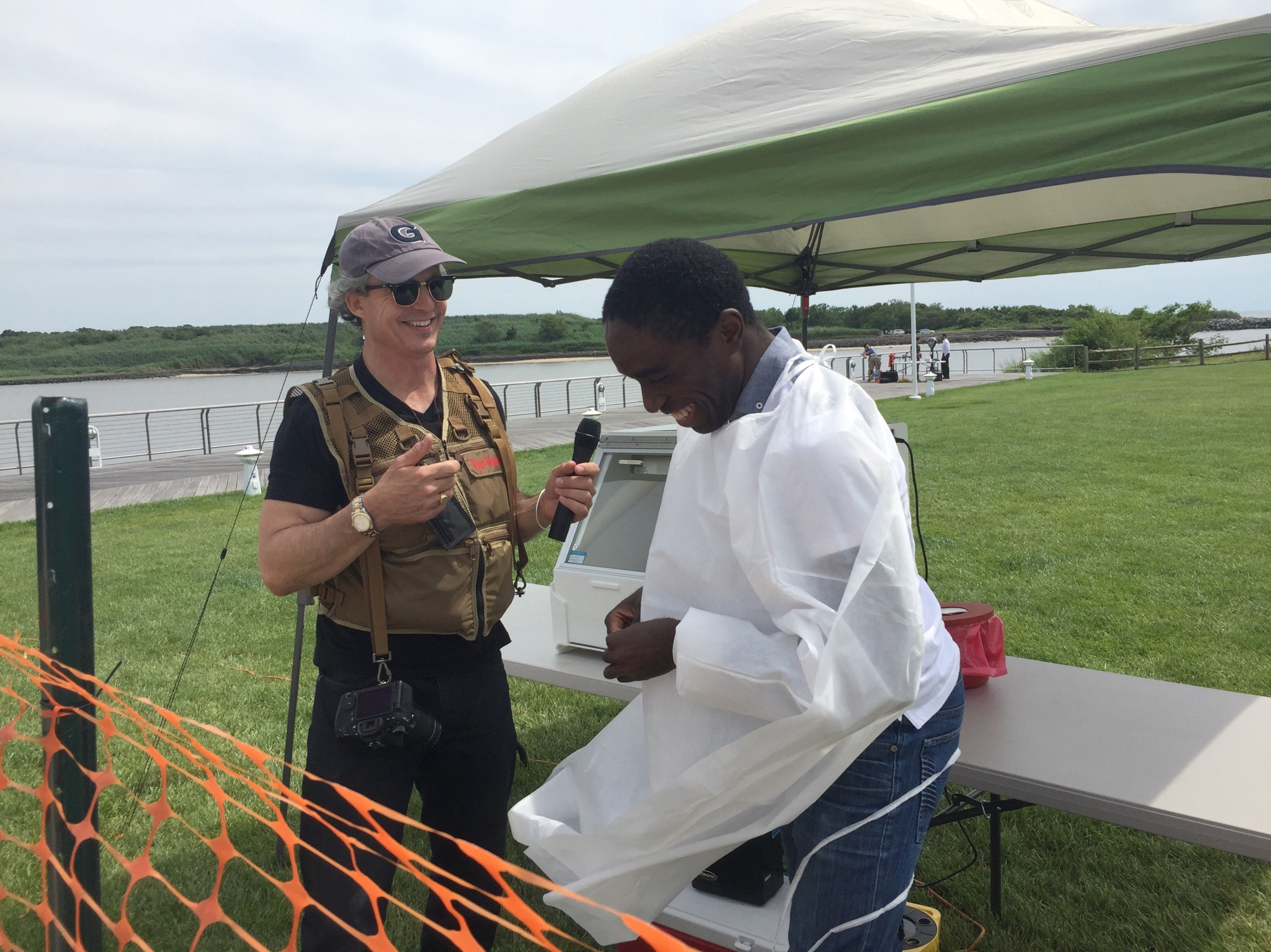 Dr. Timothy Amukele (right), of Johns Hopkins University Hospital, and Mark A. Ryan (left), CEO of Ryan Media Lab, prepare for the autonomous Flirtey missions transporting sample human specimens from the shores of Cape May, N.J., to an ocean vessel, completing America's first ship-to-shore autonomous drone delivery.