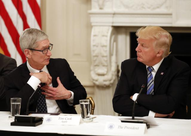 Tim Cook, Chief Executive Officer of Apple, speaks as President Donald Trump listens during an American Technology Council roundtable in the State Dinning Room of the White House, Monday, June 19, 2017, in Washington. (AP Photo/Alex Brandon)