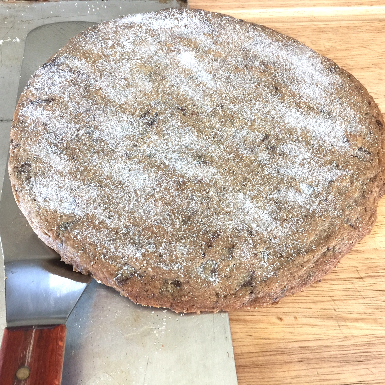 After it is baked, sprinkle the top with sugar. Using a large spatula,slide the disk onto a work surface.
