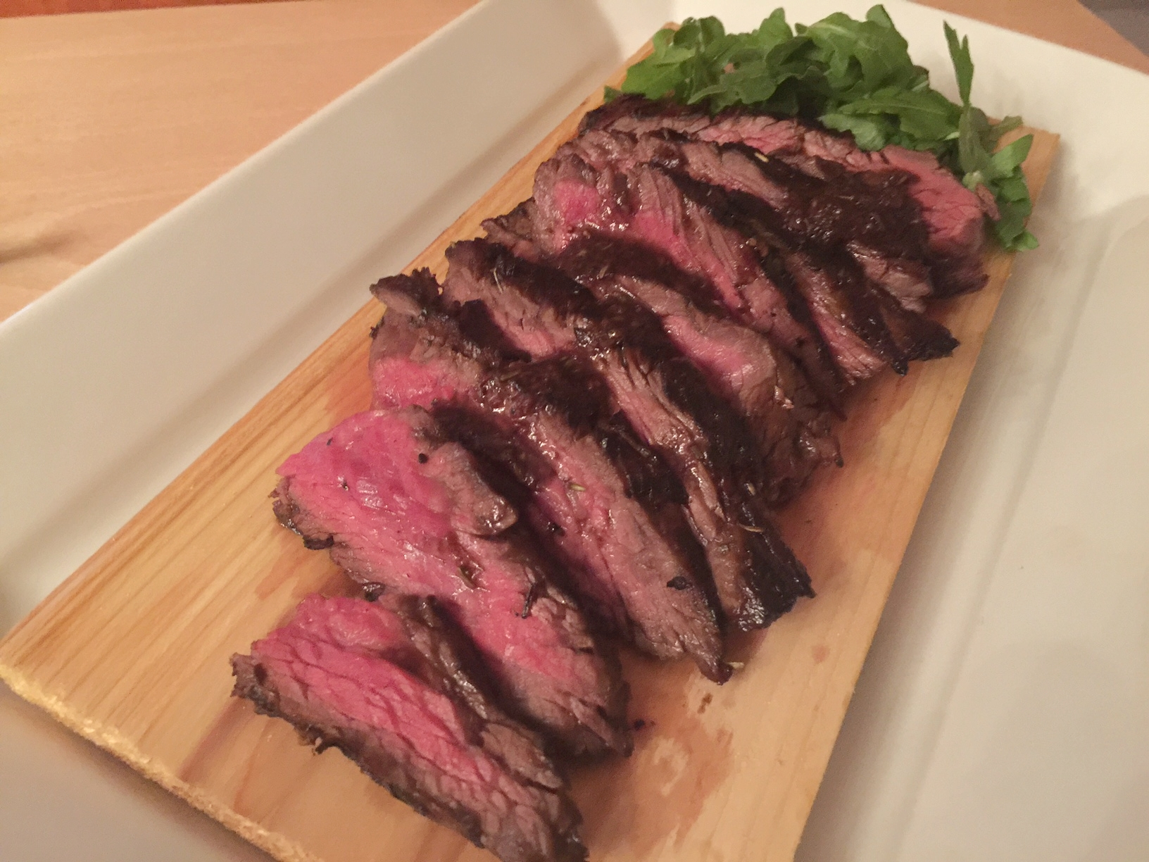 Can you guess which type of steak is pictured? Bet you can't, because they all look very similar. This one happens to be a delicious, juicy skirt steak cooked to 125 degrees.Garnish with baby arugula.