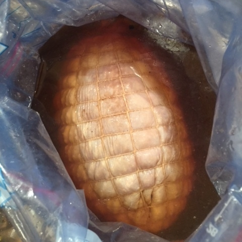 Here is the roast in a bag filled with the marinade. The turkey floats to the top.