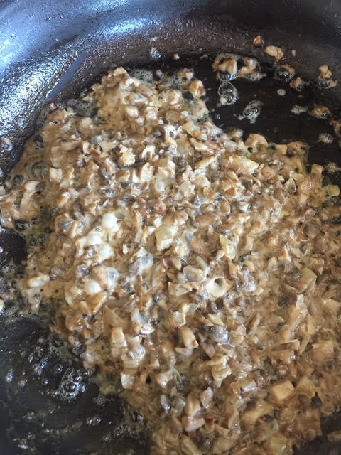 Reduce the cream until the mushrooms become creamy and the sauce lightly coats the bottom of the skillet.