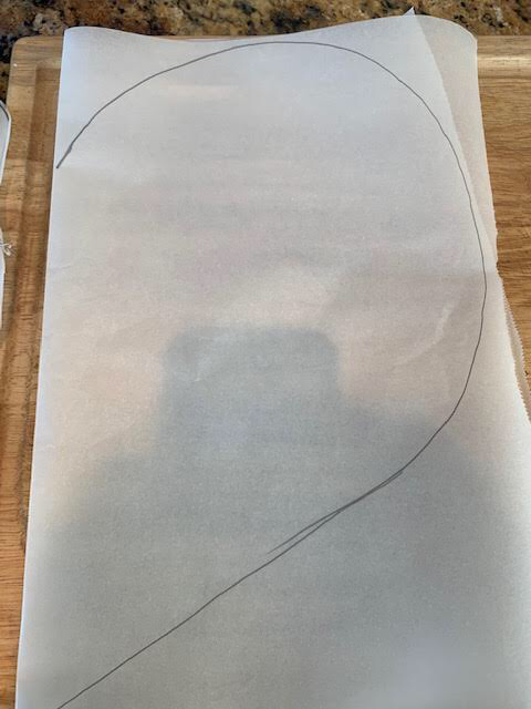 """Fold parchment in half and draw a heart about 15""""x 8"""" wide."""