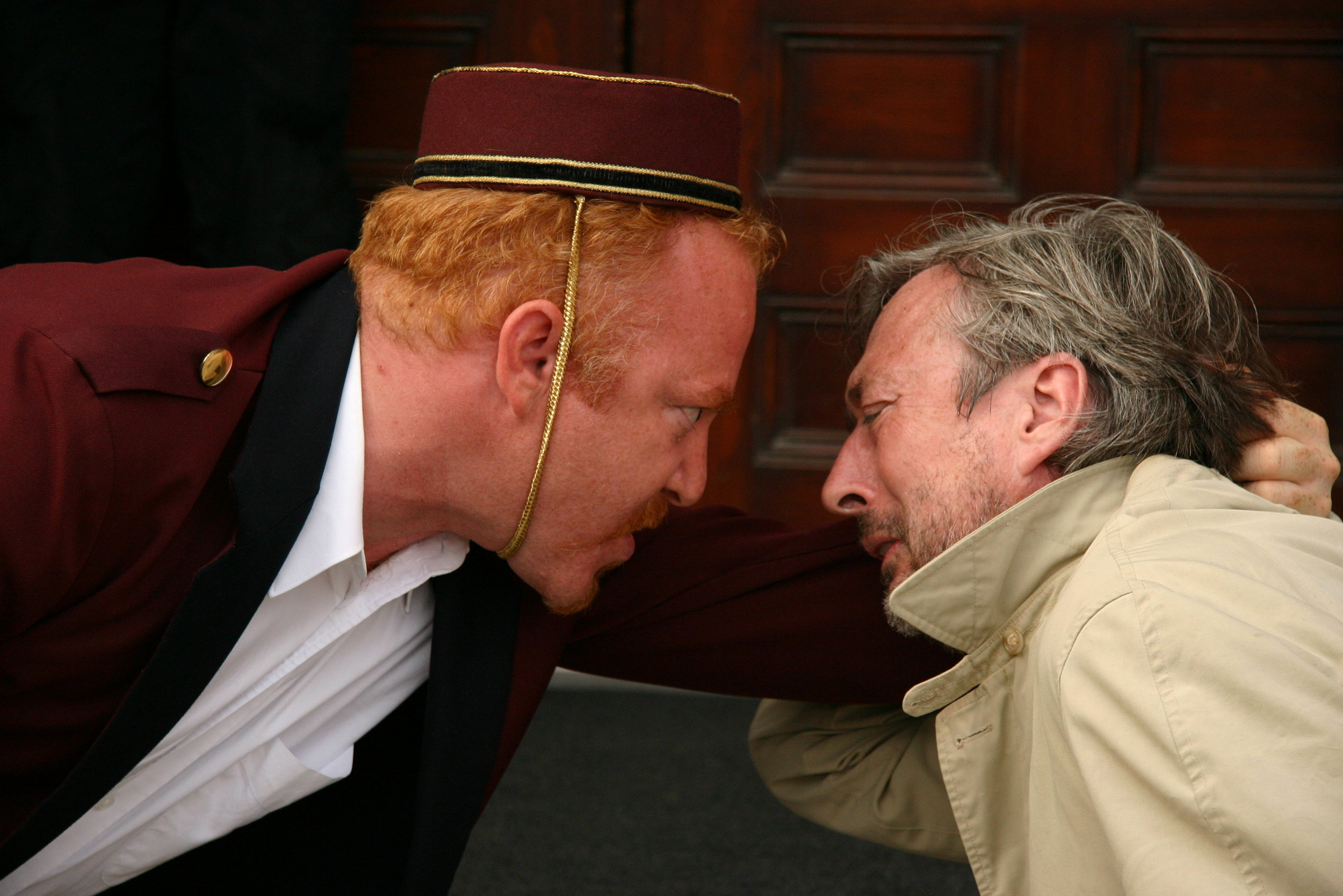 Dov Mickelson as The Concierge & Richard McMillan as The Man in  The Card Trick  by Brendan Gall