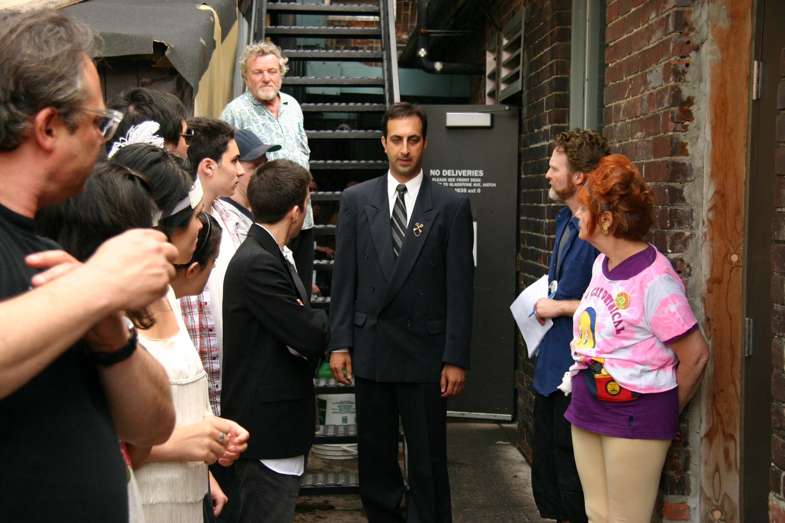 Sanjay Talwar as The Concierge in a dress rehearsal of  The Card Trick  by Brendan Gall, as Director Alan Dilworth and fellow TGV cast members watch on