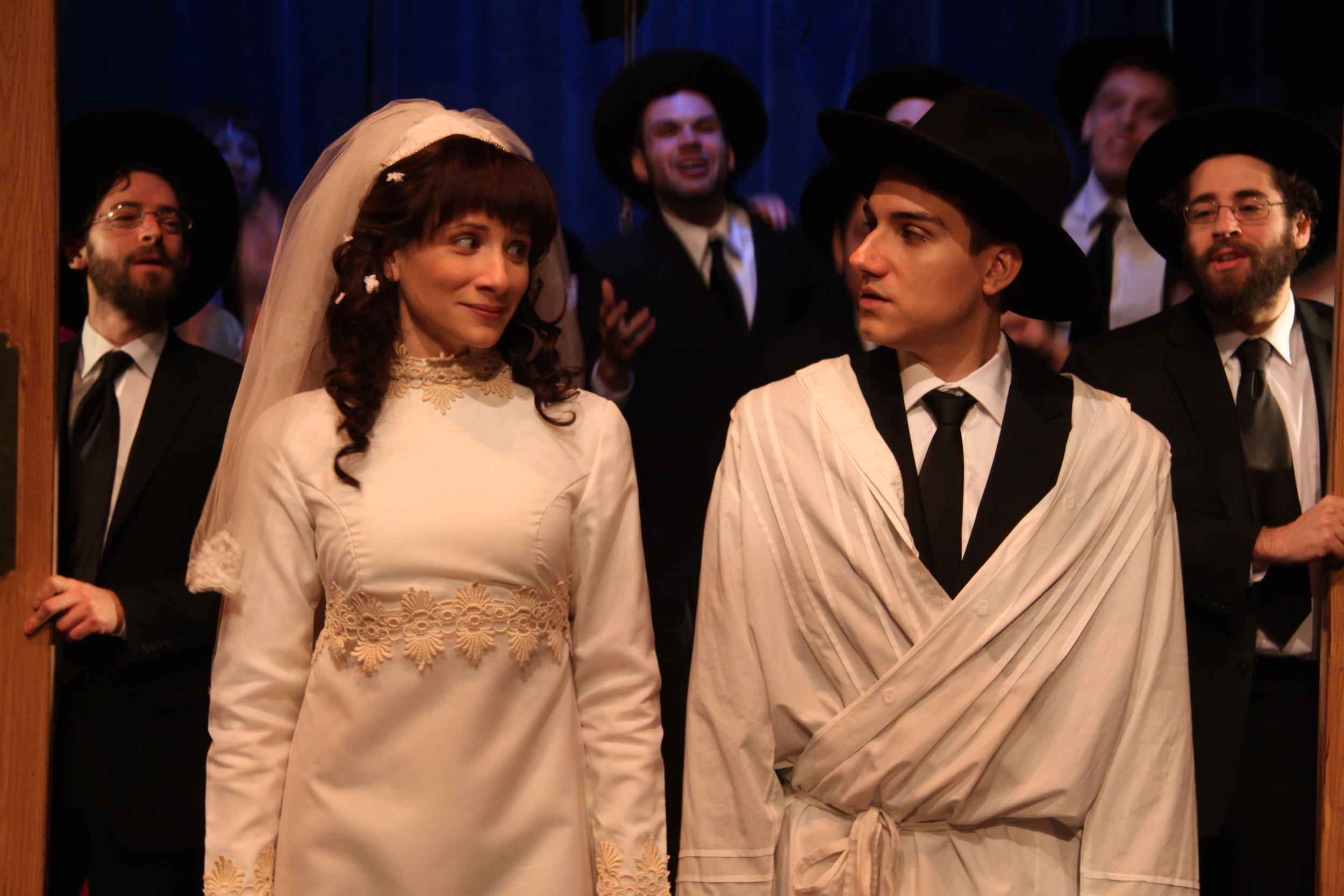 Julie Tepperman as Rachel and Aaron Willis as Chaim with members of the Cast in YICHUD (Seclusion)