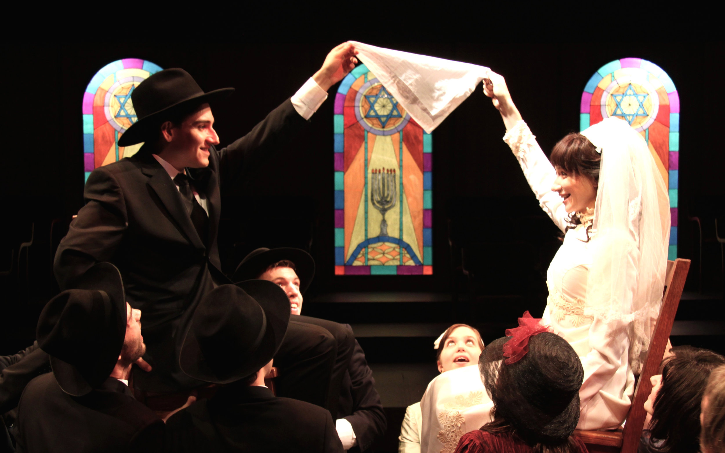 Julie Tepperman as Rachel and Aaron Willis as Chaim with members of the Chorus in YICHUD (Seclusion)