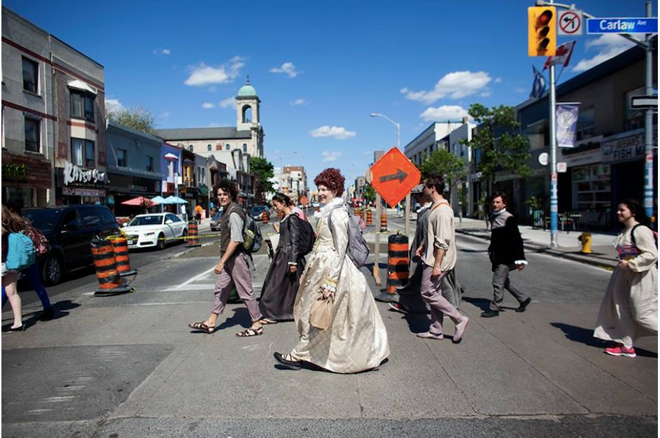 Members of the Passion Play Cast walking across The Danforth from Withrow Park (after the dress rehearsal of Part One) to East Minster United Church for Parts Two & Three