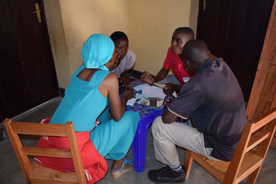 Jeanette, Elise, Pastor Kaneza and Pelagie in discussion.