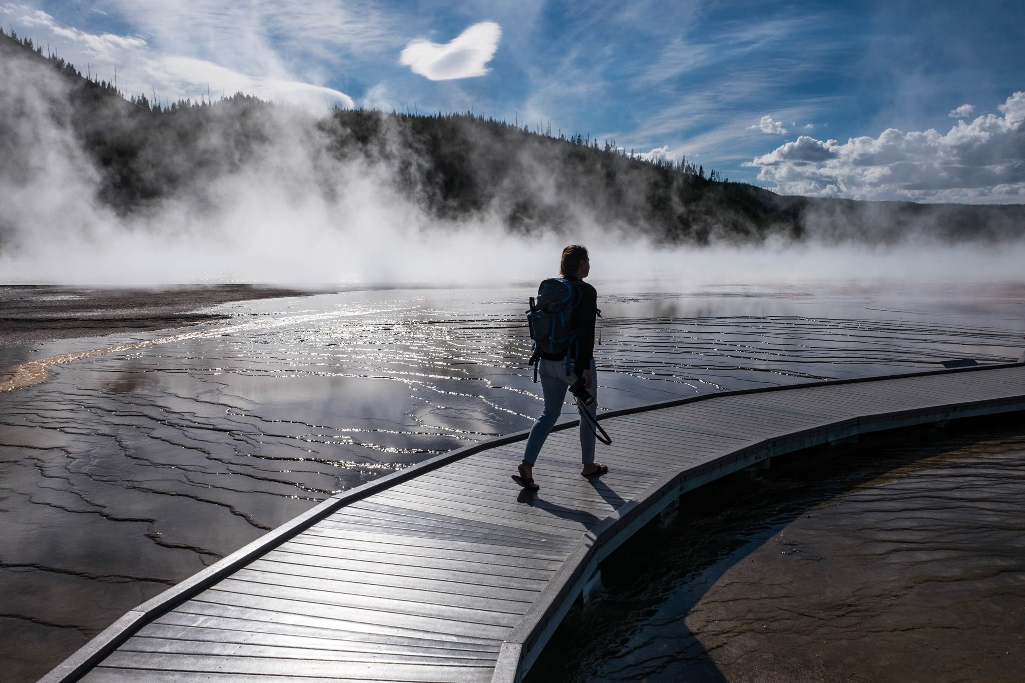 Walking through the geothermal features at Grand Prismatic Spring at Yellowstone National Park in Wyoming/Montana/Idaho