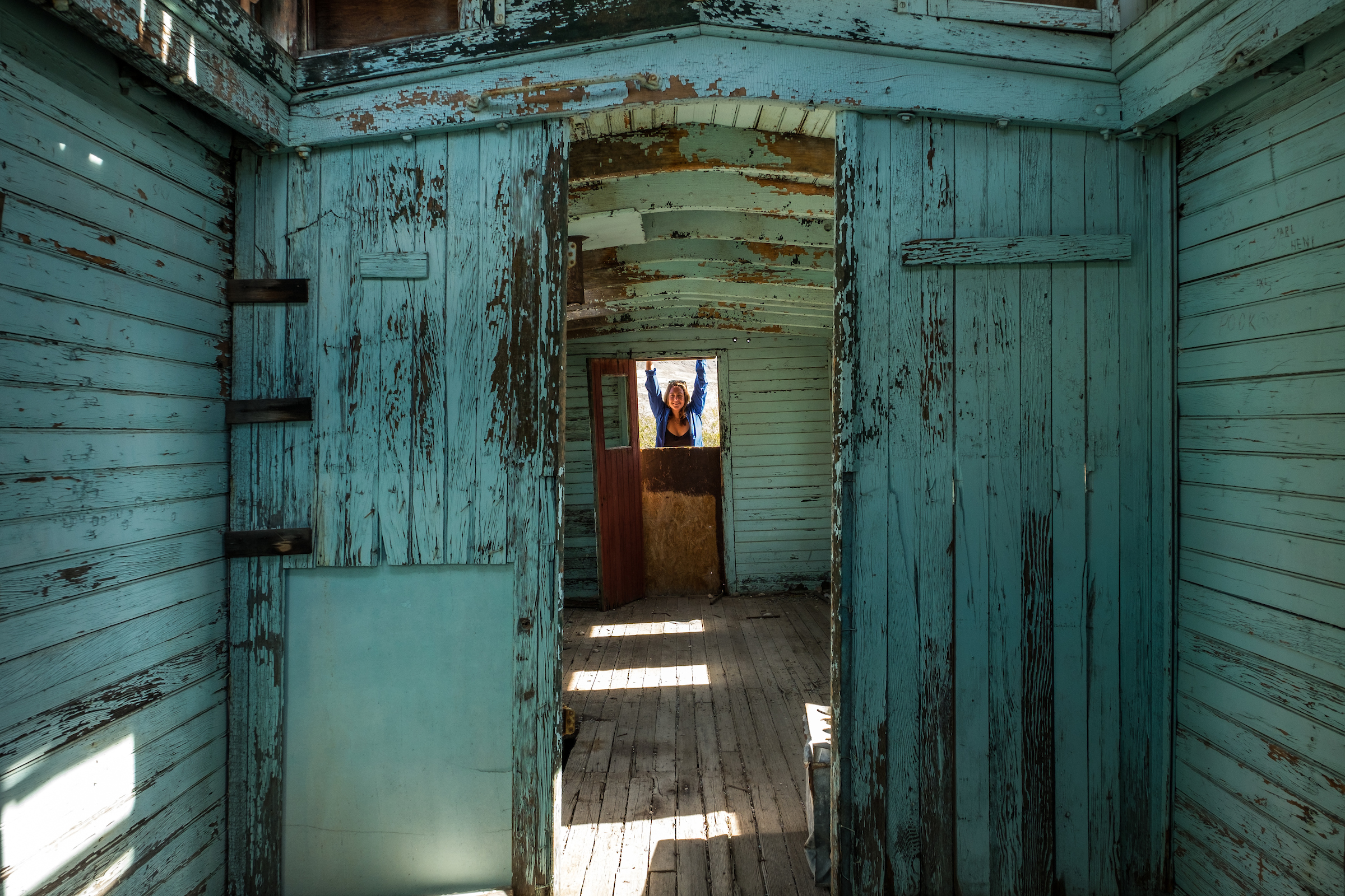 At an old rail car at the Rhyolite Ghost Town on the Nevada side of Death Valley National Park bordering California