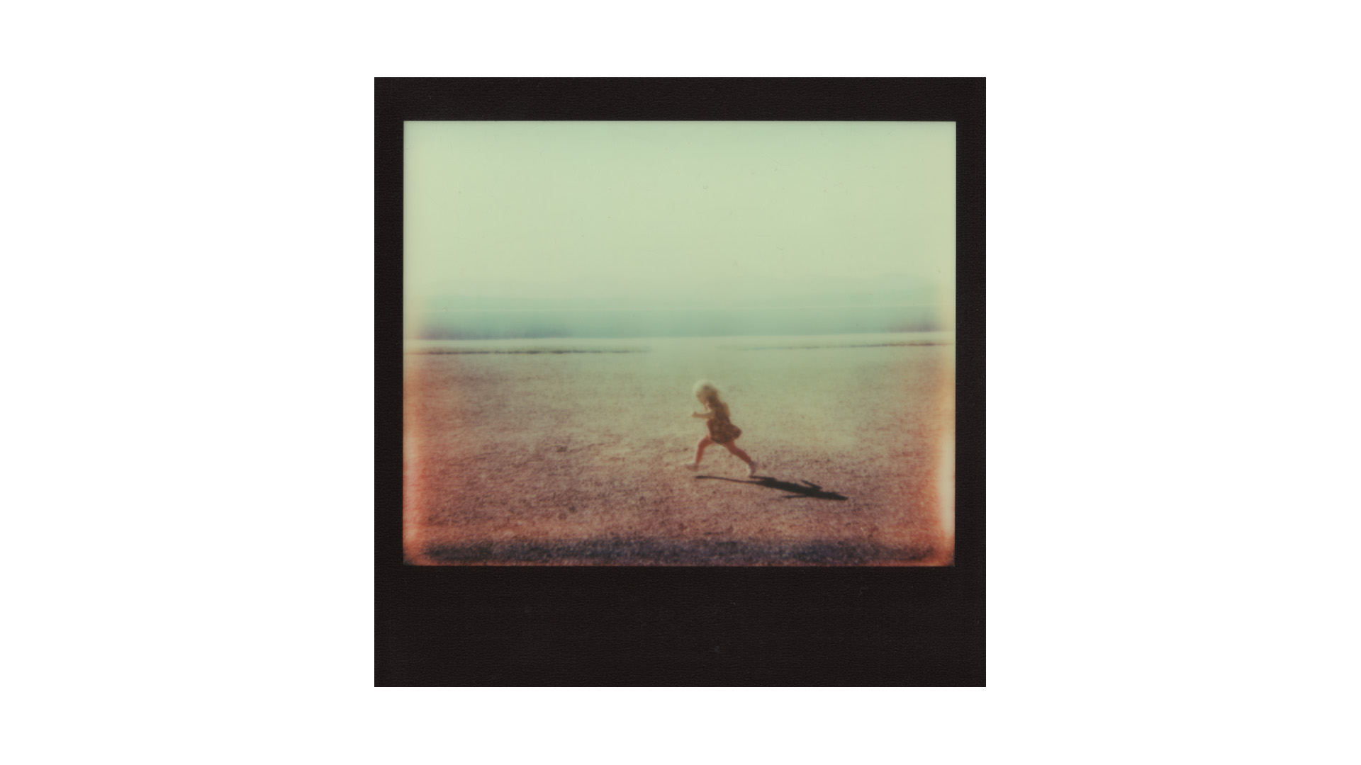 polaroid SPECTRA portrait of child running // (c) jocelynmathewes.com