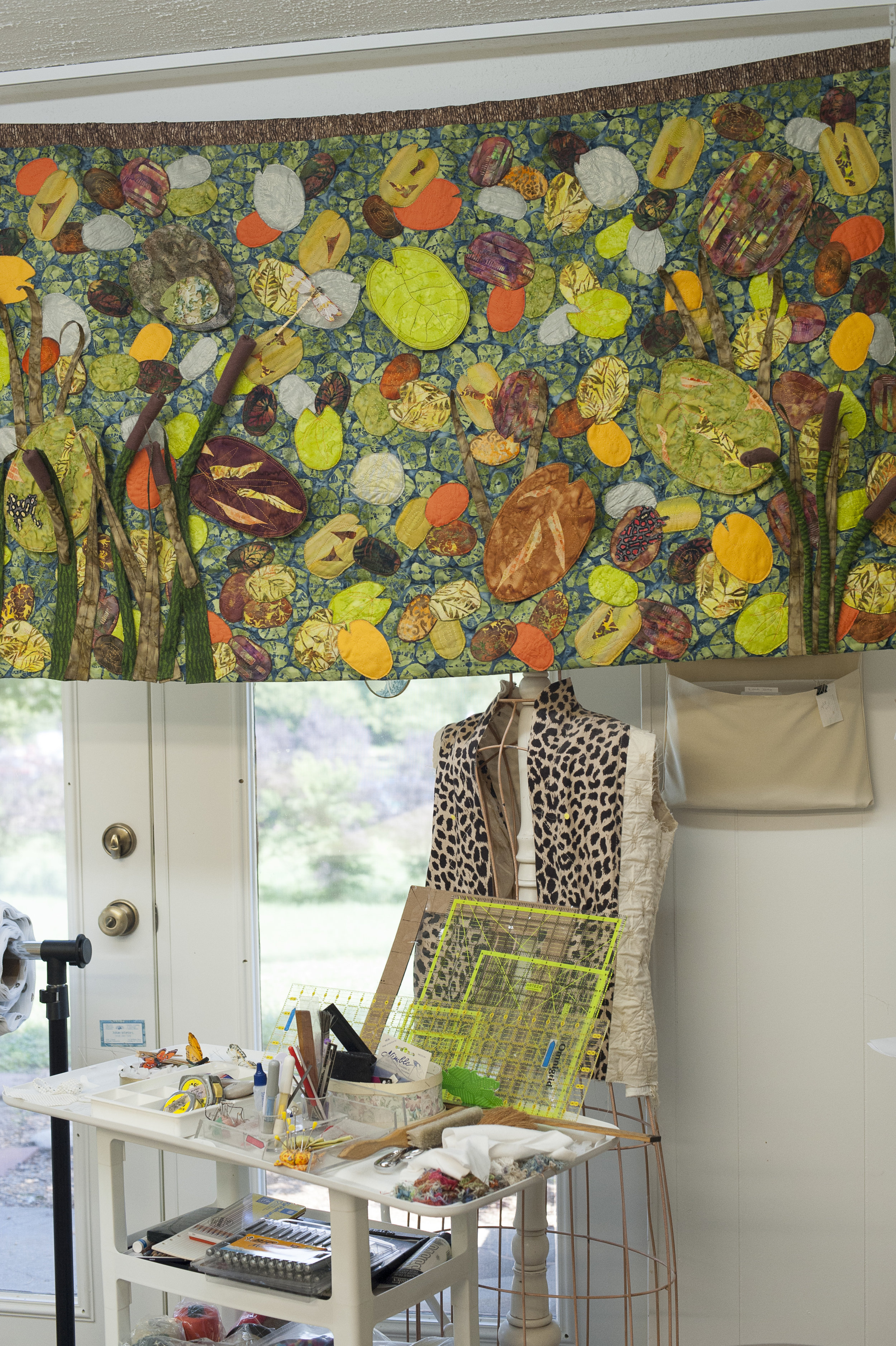 a work of lily pads hanging in Joan's studio