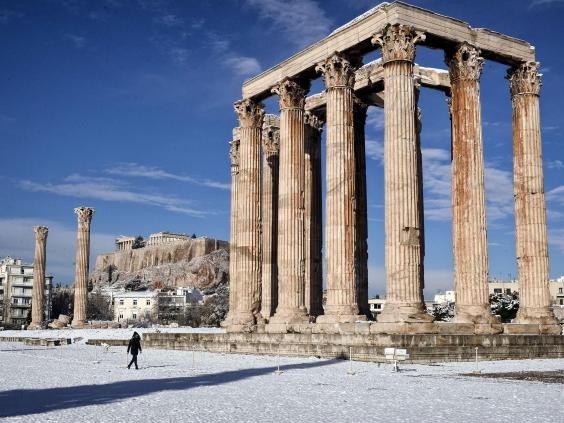 The archaeological site of Olympion Zeus in Athens, Greece after rare snowfall on the city (10 January 2017); image courtesy AFP/Getty Images