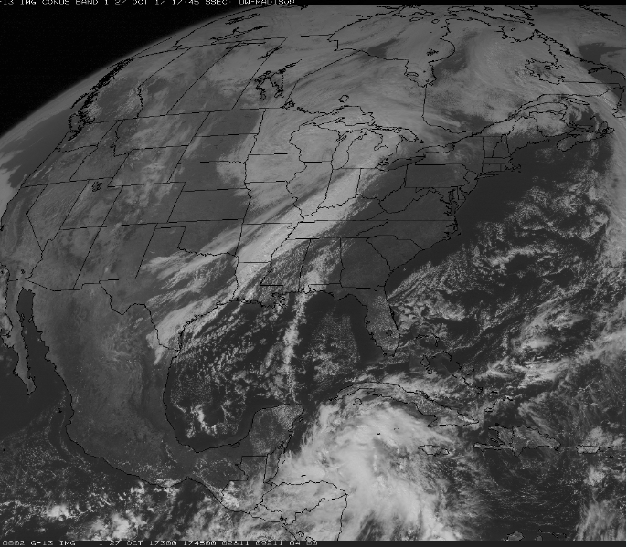 """Latest GOES-16 visible satellite image featuring deep upper-level trough heading into the Tennessee Valley and a batch of showers and thunderstorms over the Caribbean Sea associated with """"Invest 93L"""". Image courtesy NOAA/GOES"""