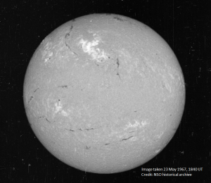 A solar image on May 23rd, 1967 features a bright region (top, center) which is where the solar flare occurred on that day. Credit: National Solar Observatory historical archive, American Geophysical Union