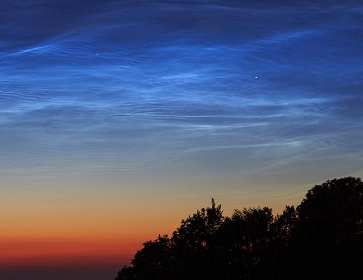 Noctilucent clouds over Herzogswalde, Germany on June 17th. Credit: Heiko Ulbricht,  spaceweather.com