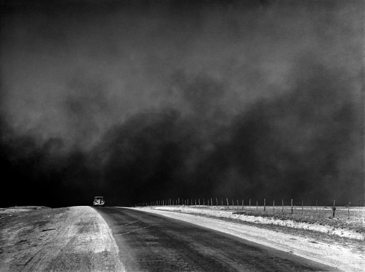 Photograph of a dust storm captured in the Texas Panhandle during March 1936. When the drought and dust storms showed no signs of letting up, many people abandoned their land. The Dust Bowl exodus was the largest migration in American history. By 1940, 2.5 million people had moved out of the Plains states of which 200,000 moved to California. Courtesy  PBS