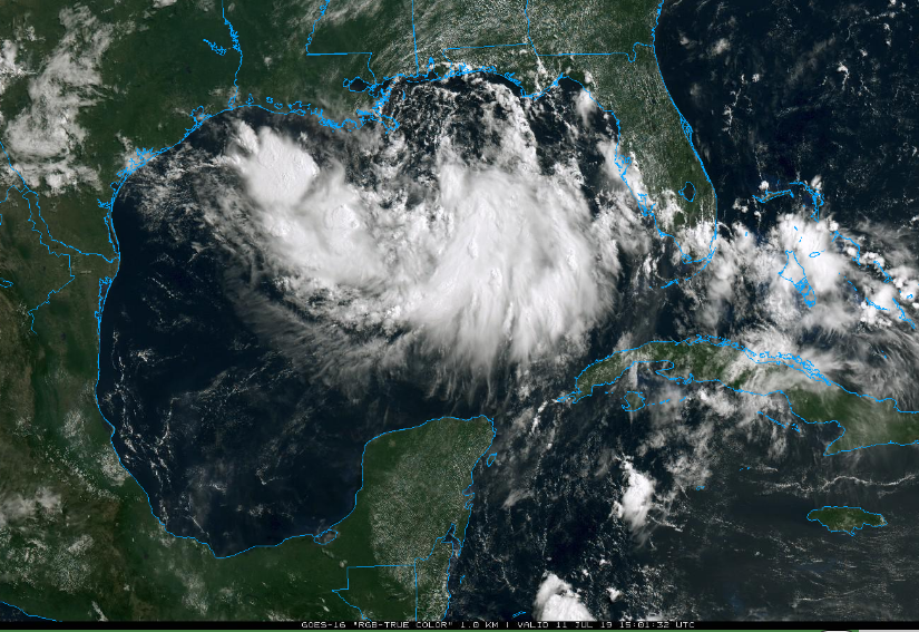 "Latest satellite image shows a broad area of clouds over the Gulf of Mexico. Intensification later today and tonight should result in a more well defined center in what is likely to become ""Barry"". Courtesy NOAA, College of DuPage"