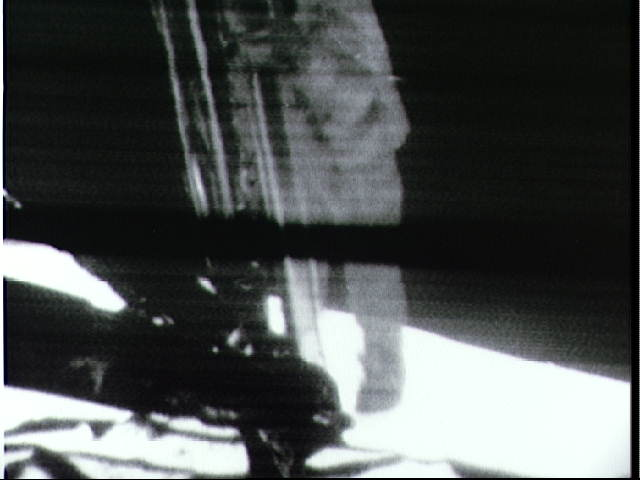 This is the scene on television witnessed by millions on Earth as Neil Armstrong descends the Lunar Module ladder just prior to becoming the first human being to set foot on the Moon.