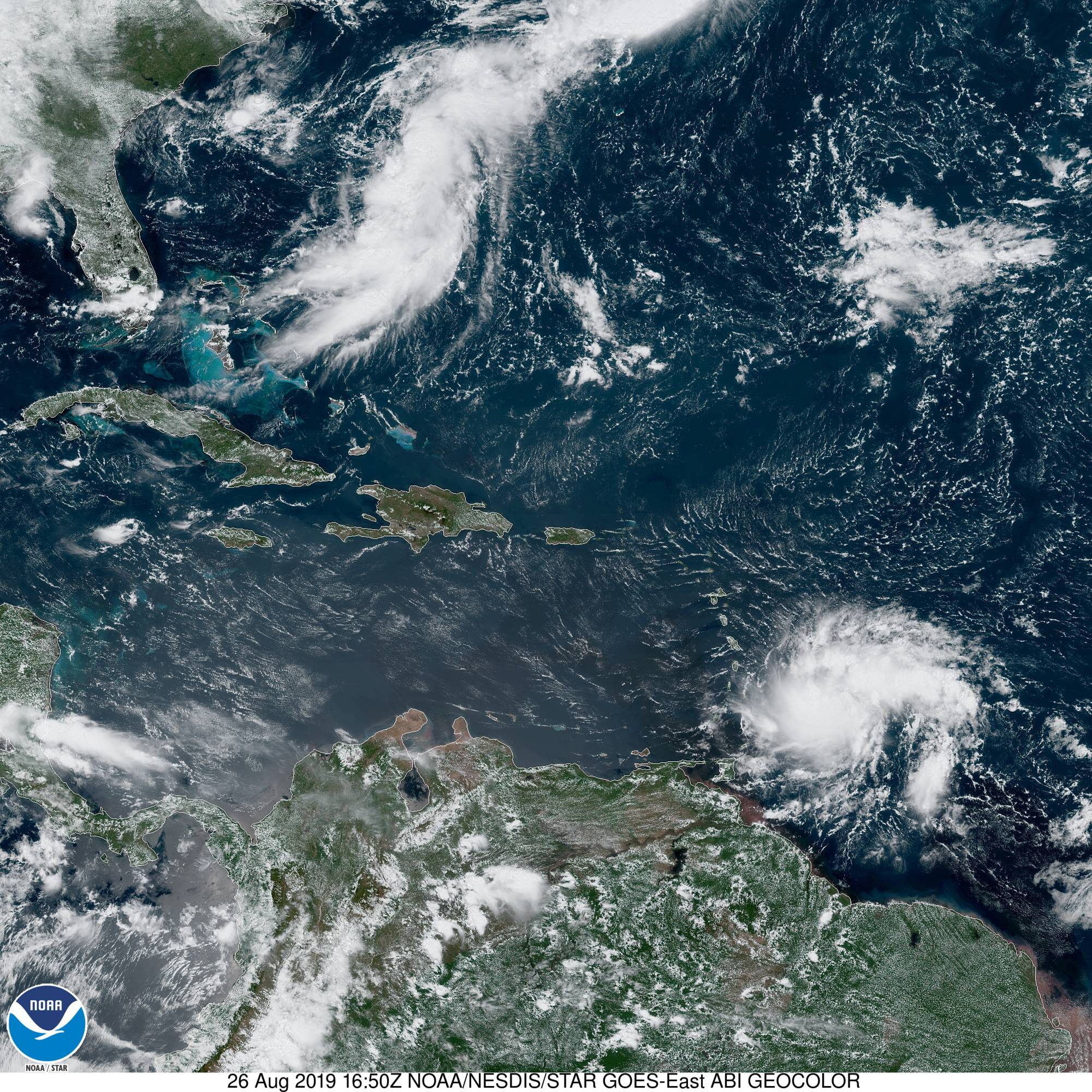 "The latest GOES-East ""Geocolor"" satellite image shows the two areas of interest with Tropical Storm Dorian (lower, right) and an elongated area of clouds over the western Atlantic (upper, left). Courtesy NOAA/NESDIS/STAR"