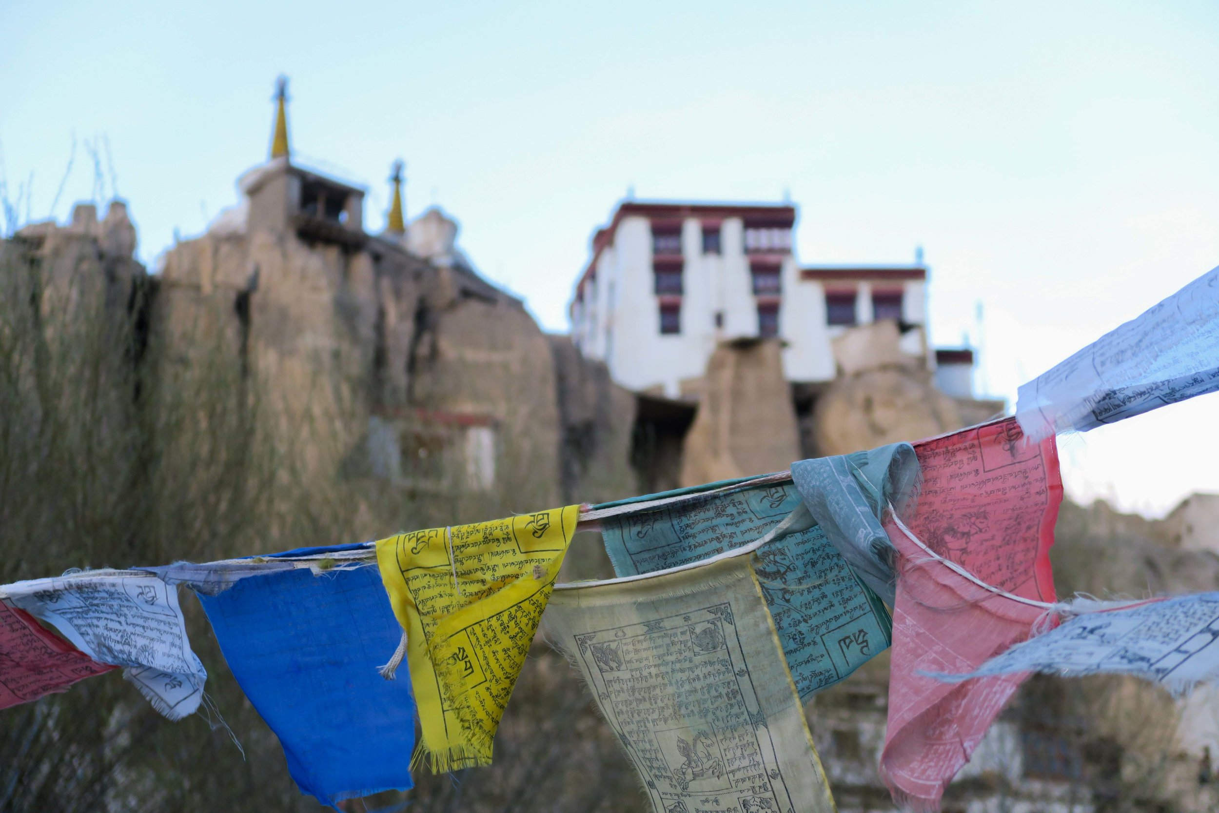 Lamayuru Monastery overlooks rooftop prayer flags