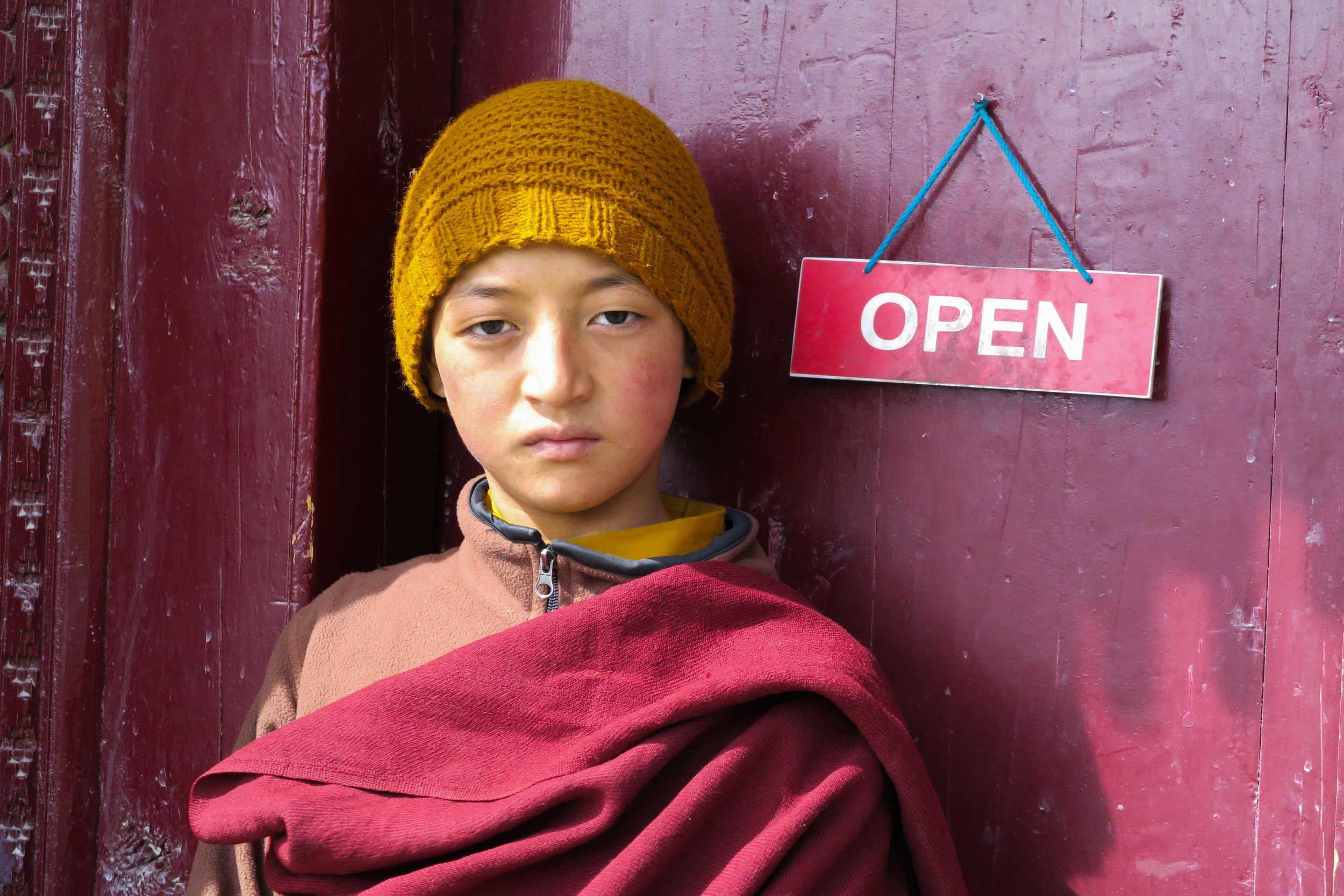 Young monks welcome visitors to the Lamayuru Monastery