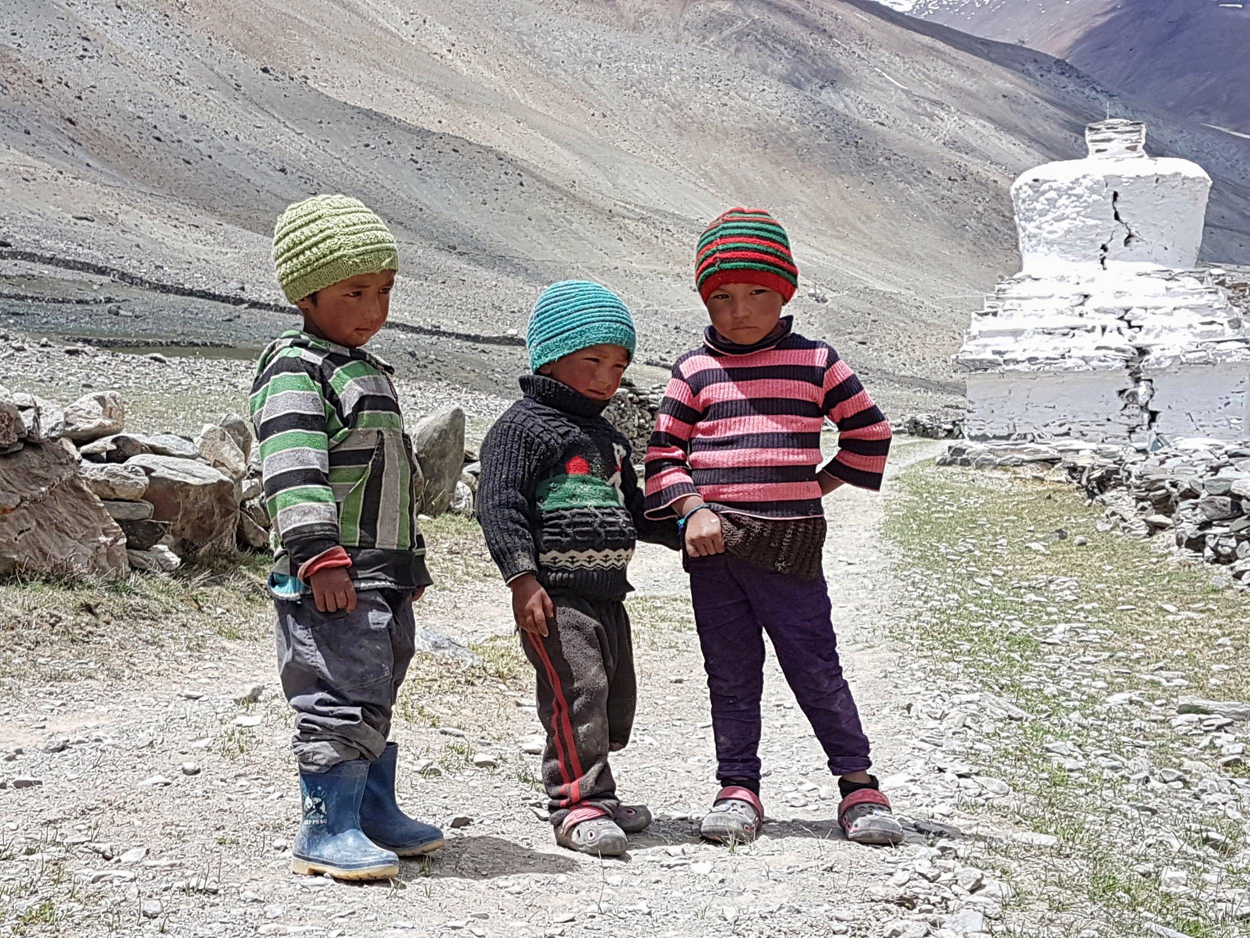 Kids play around the stoopas