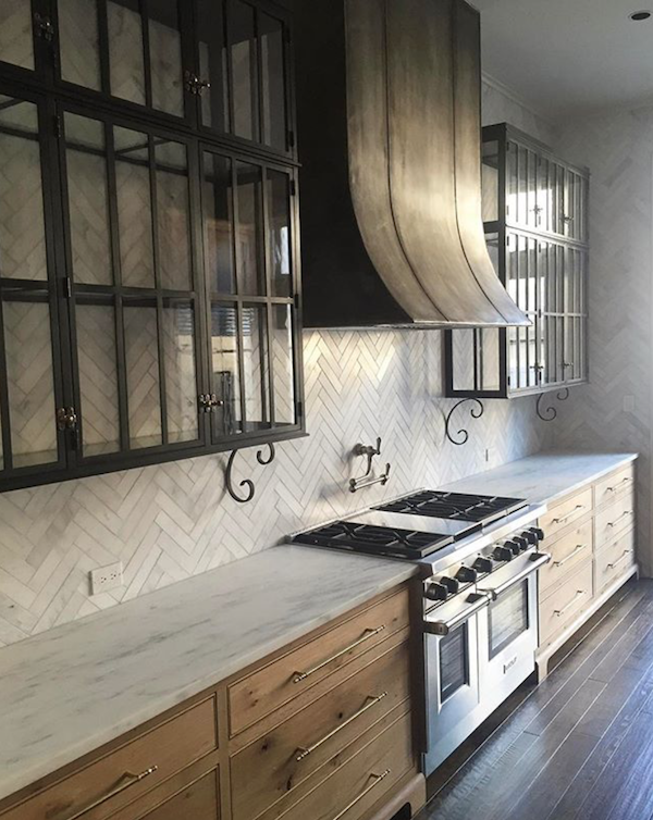 Statement Hoods - Statement hoods in all shapes and materials are on the rise. This utilitarian kitchen element is gaining center stage with the range nowadays.Construction by Francis Bryant Construction