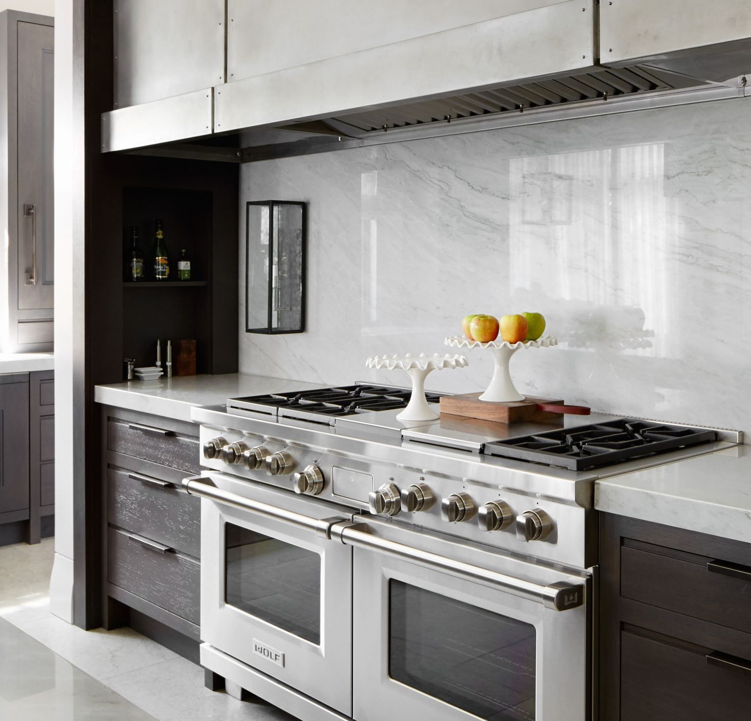 Oversized Hoods - Here's an example of a super wide vent hood with no wall cabinets - this a new clean look that is becoming more and more popular in today's modern and traditional kitchens.Design by O'Brien Harris Kitchens