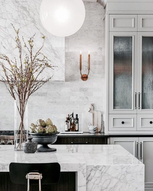 Light the Hood - Following the idea of giving the vent hood more space in general, another design element we like to use more often now is placing sconces next to the hood and extending the backsplash all the way up to the ceiling.